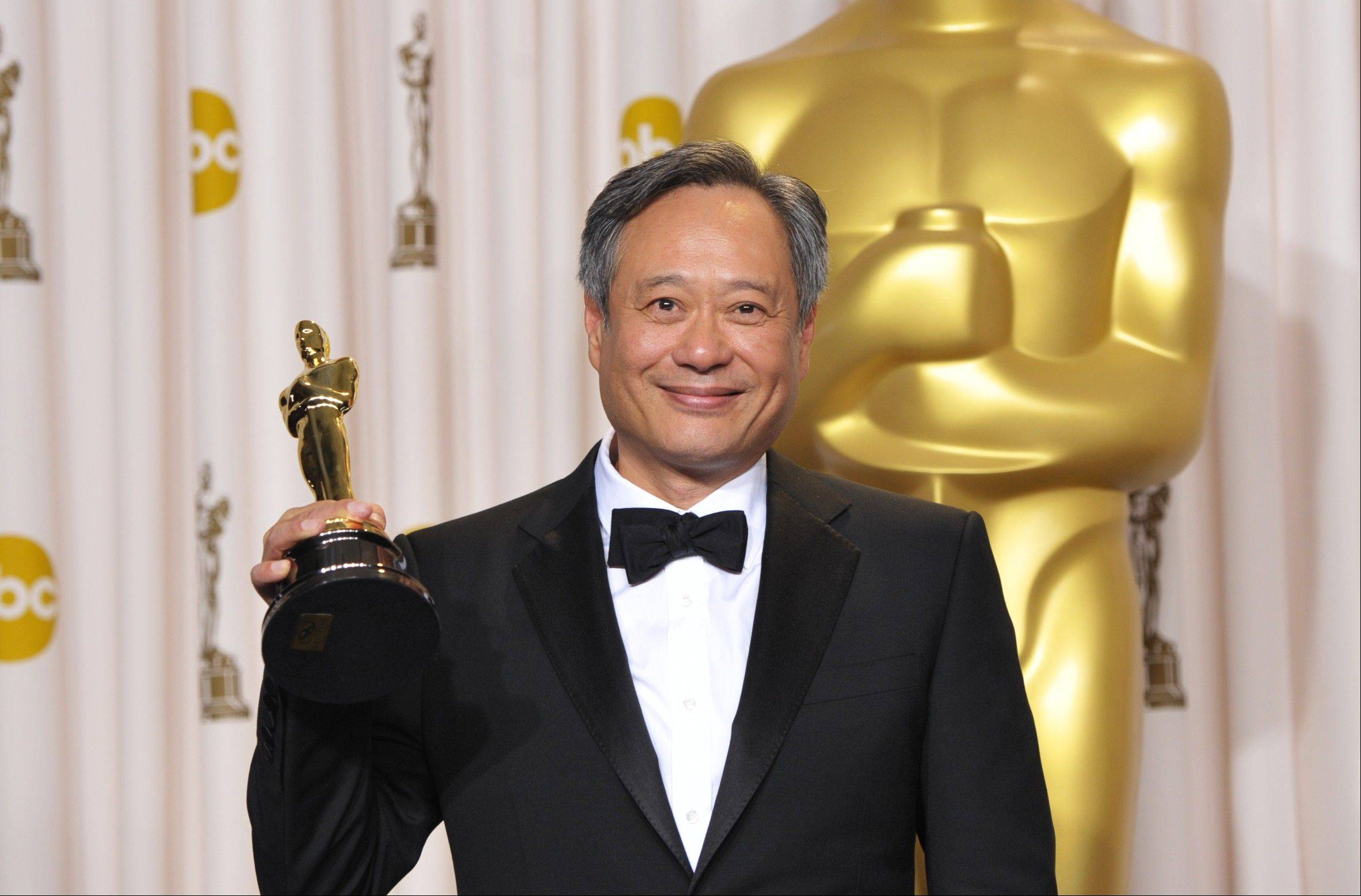 "Ang Lee poses with his award for best directing for ""Life of Pi"" during the Oscars on Sunday."