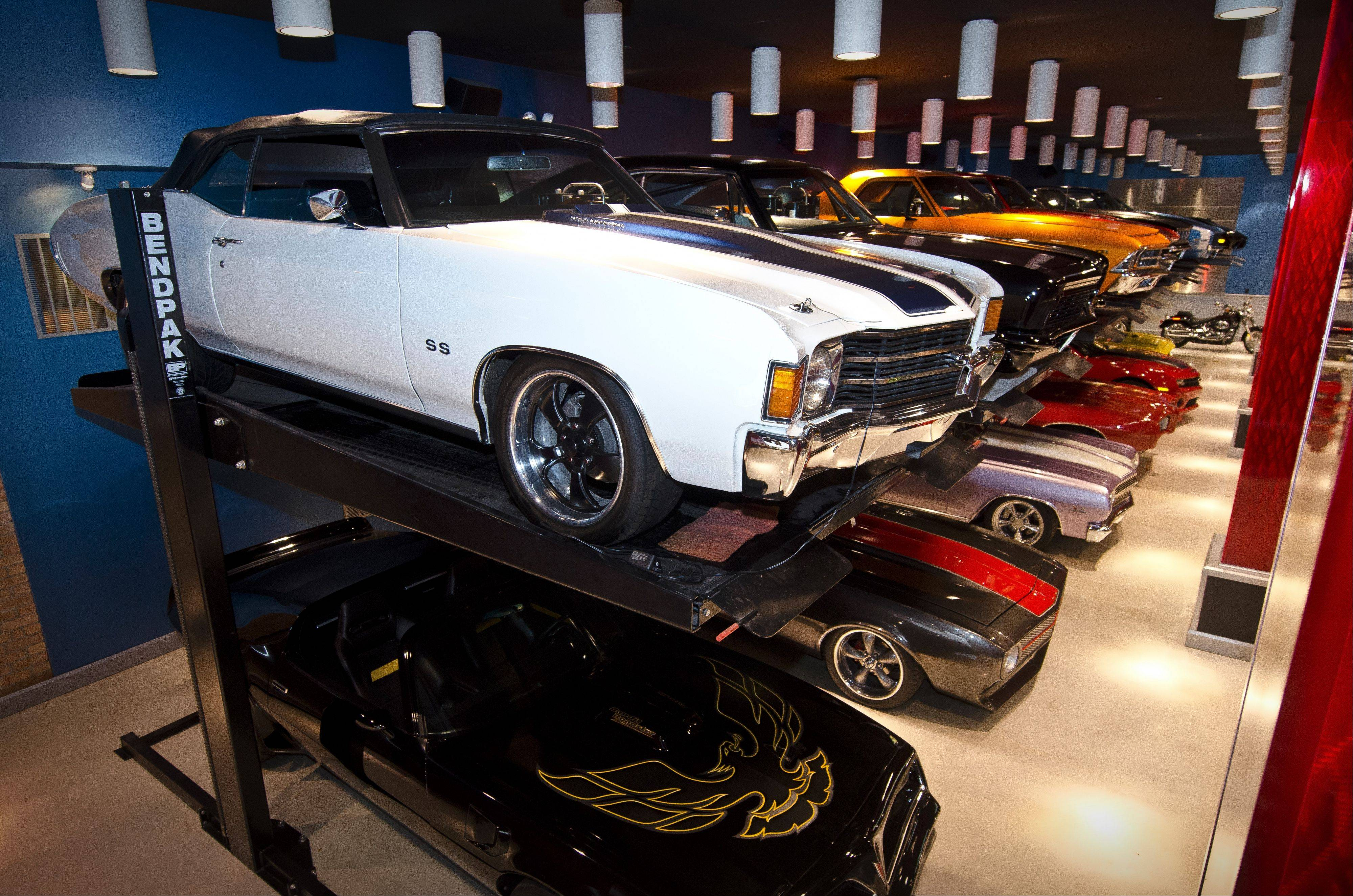 A series of car lifts allows Wisniewski to park and display more cars in his Vegas-themed showroom.