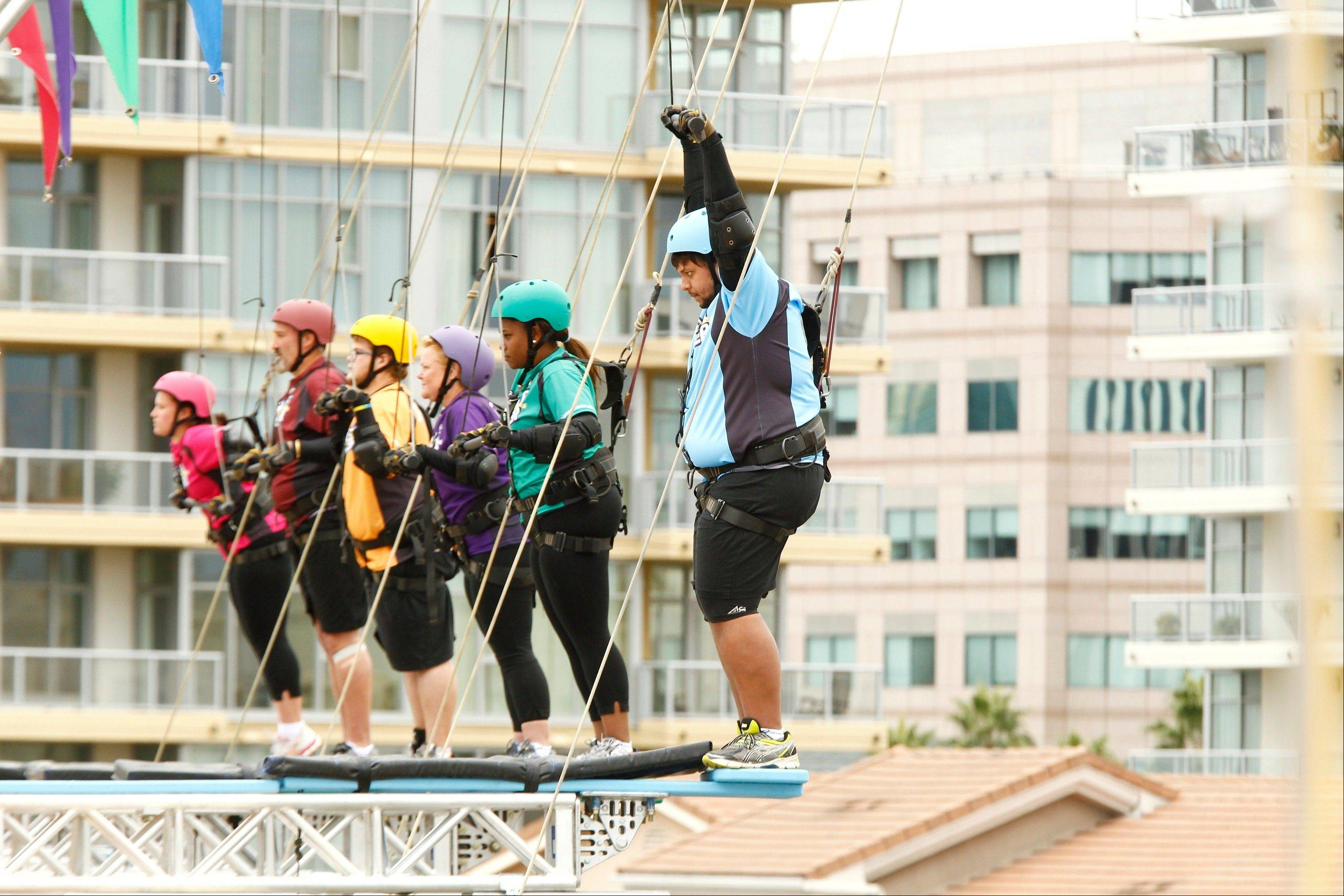 "From left to right, Wheeling's Danni Allen, Joe Ostaszewski, Jackson Carter, Gina McDonald, Alexandra ""Alex"" Reid, Jeff Nichols try to conquer their fears on ""The Biggest Loser."""