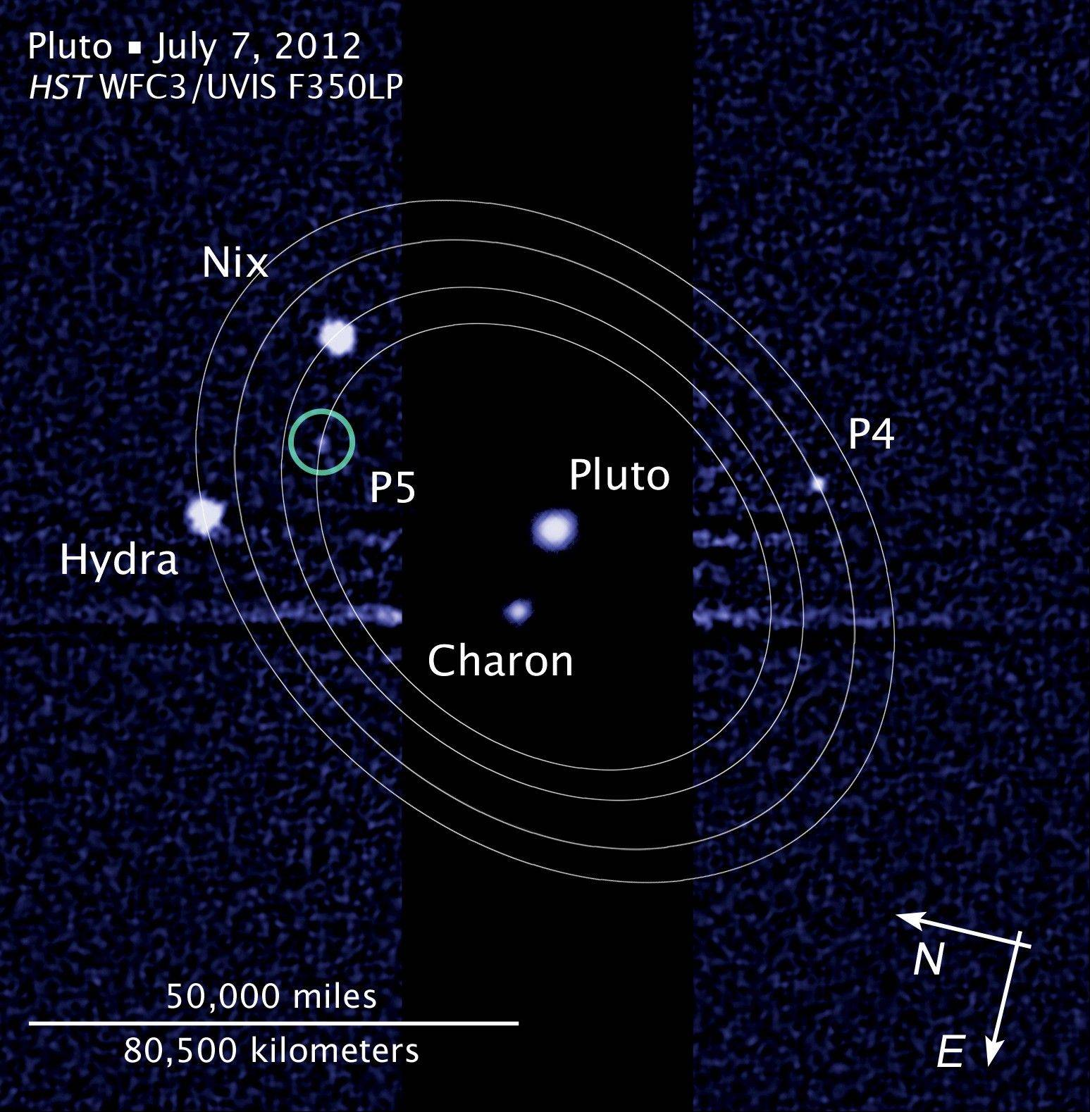"This graphic shows the five moons in their orbits around Pluto. An online vote to name Pluto's two newest, itty-bitty moon concluded Monday, and the winner is Vulcan, a name suggested by actor William Shatner, who played Capt. Kirk in the original ""Star Trek"" TV series."