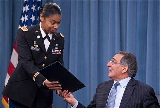 In this Jan. 24, 2013, photo Secretary of Defense Leon Panetta hands the memorandum he has just signed, ending the 1994 ban on women serving in combat, to Army Lt. Col. Tamatha Patterson of Huntingdon, Tenn., during a press briefing at the Pentagon .