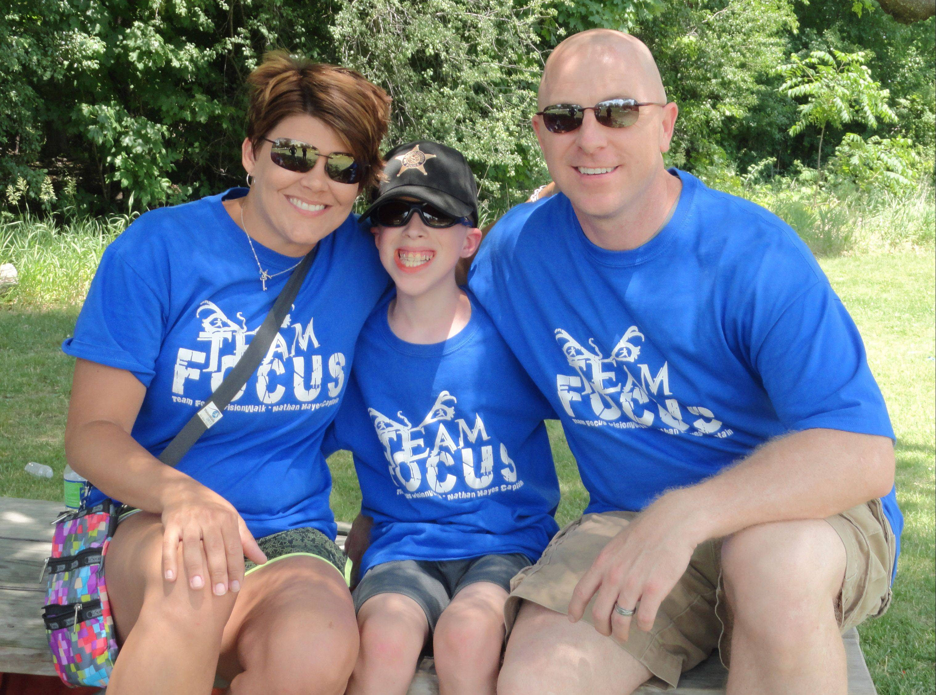 Nathan Hayes, center, with his parents, Amy and Nate Hayes, at the 2012 Chicagoland VisionWalk.