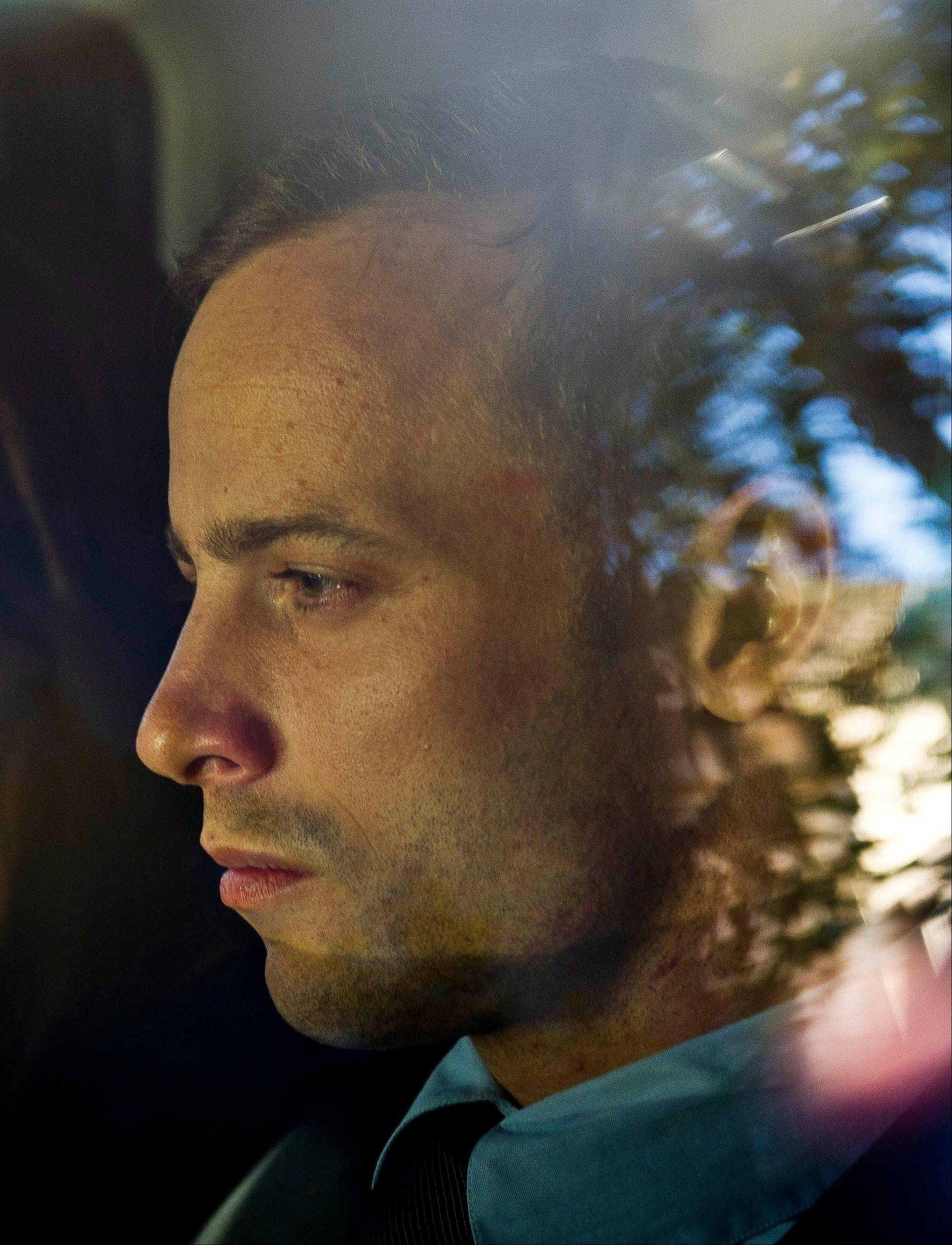 Olympic athlete Oscar Pistorius is driven to a relatives' home in Pretoria, South Africa, Friday.