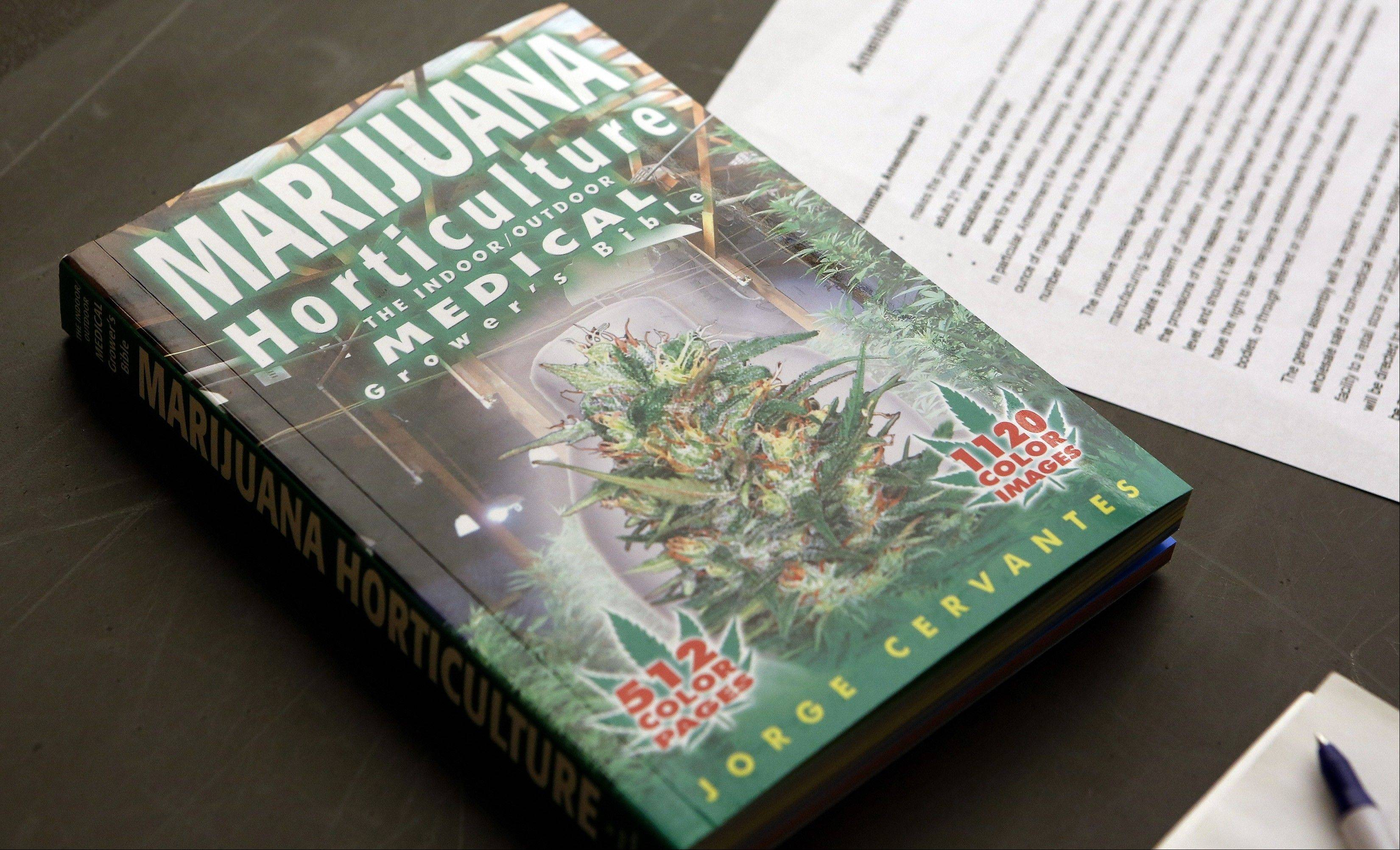 A textbook on Marijuana Horticulture sits on a desk during the first class at the THC University in Denver.