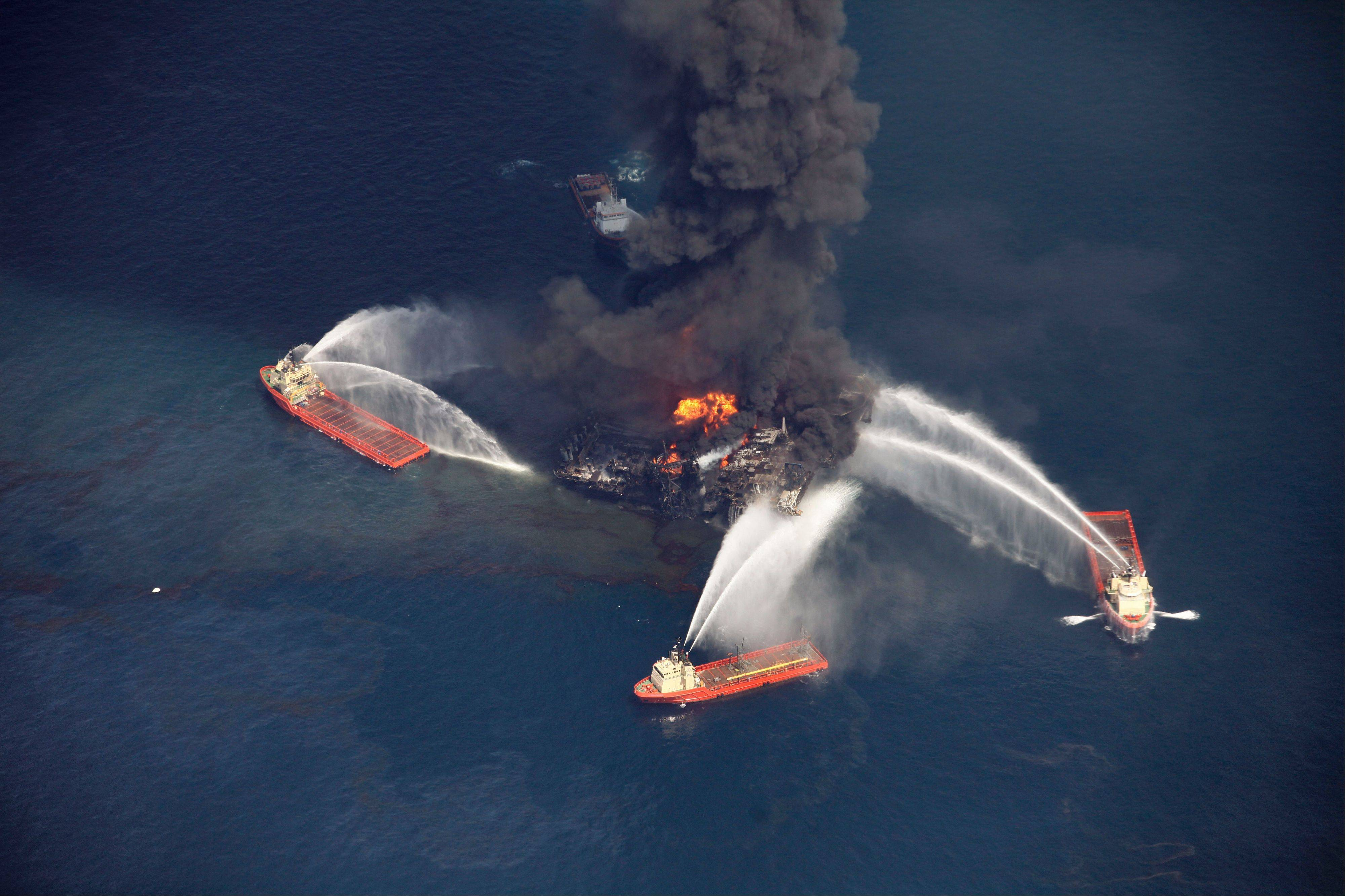 This photo from April 21, 2010, shows an oil slick as the Deepwater Horizon oil rig burns in the Gulf of Mexico, more than 50 miles southeast of Venice on Louisiana's tip. Nearly three years after the deadly rig explosion triggered the nation's worst offshore oil spill, a federal judge in New Orleans is set to preside over a high-stakes trial for the raft of litigation spawned by the disaster.