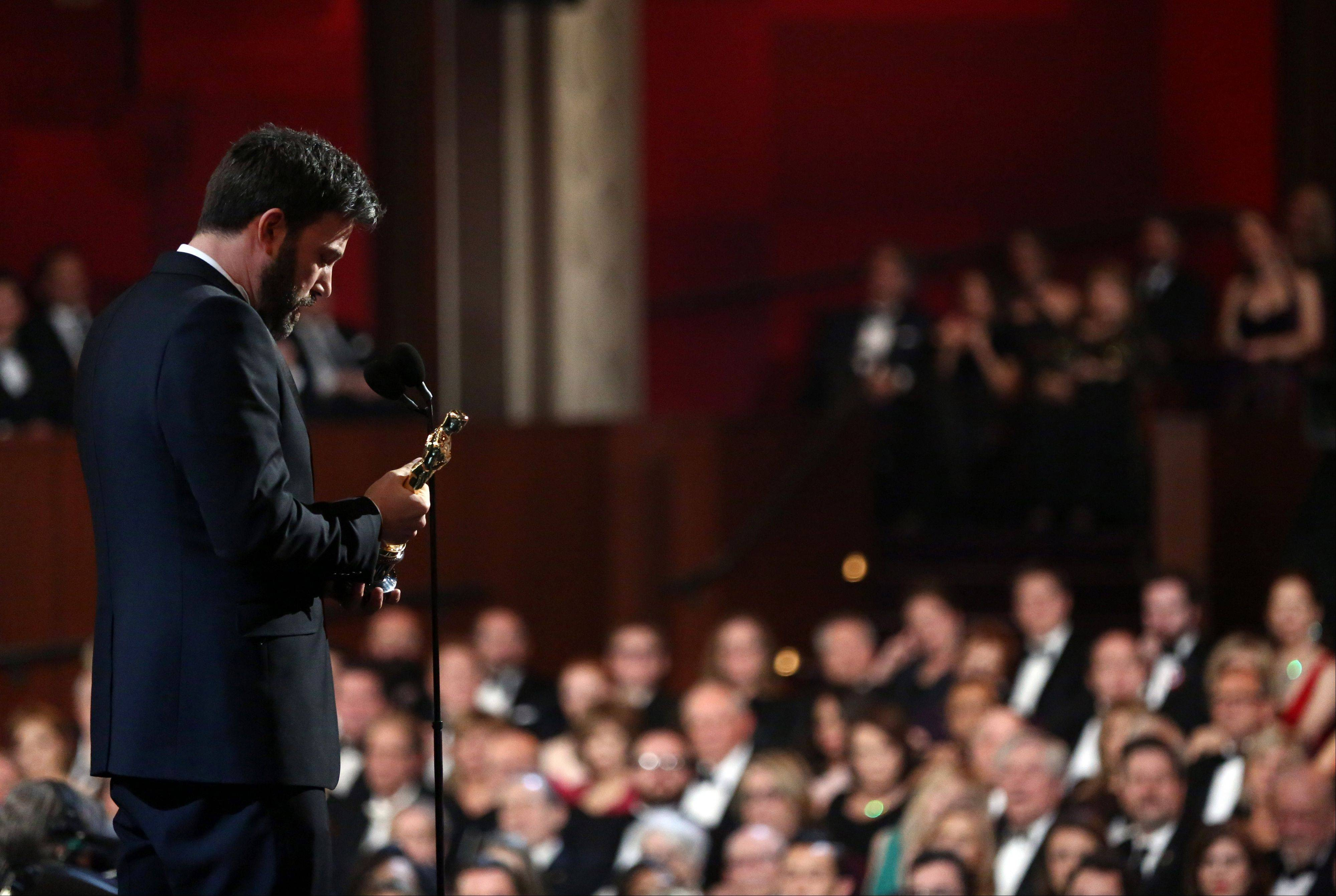 "Director/producer Ben Affleck accepts the award for best picture for ""Argo"" at the Oscars at the Dolby Theatre on Sunday night in Los Angeles. Daily Herald film critic Dann Gire says, ""If the Oscar voters hadn't given 'Argo' this award, they would have come off as the very worst sports."""