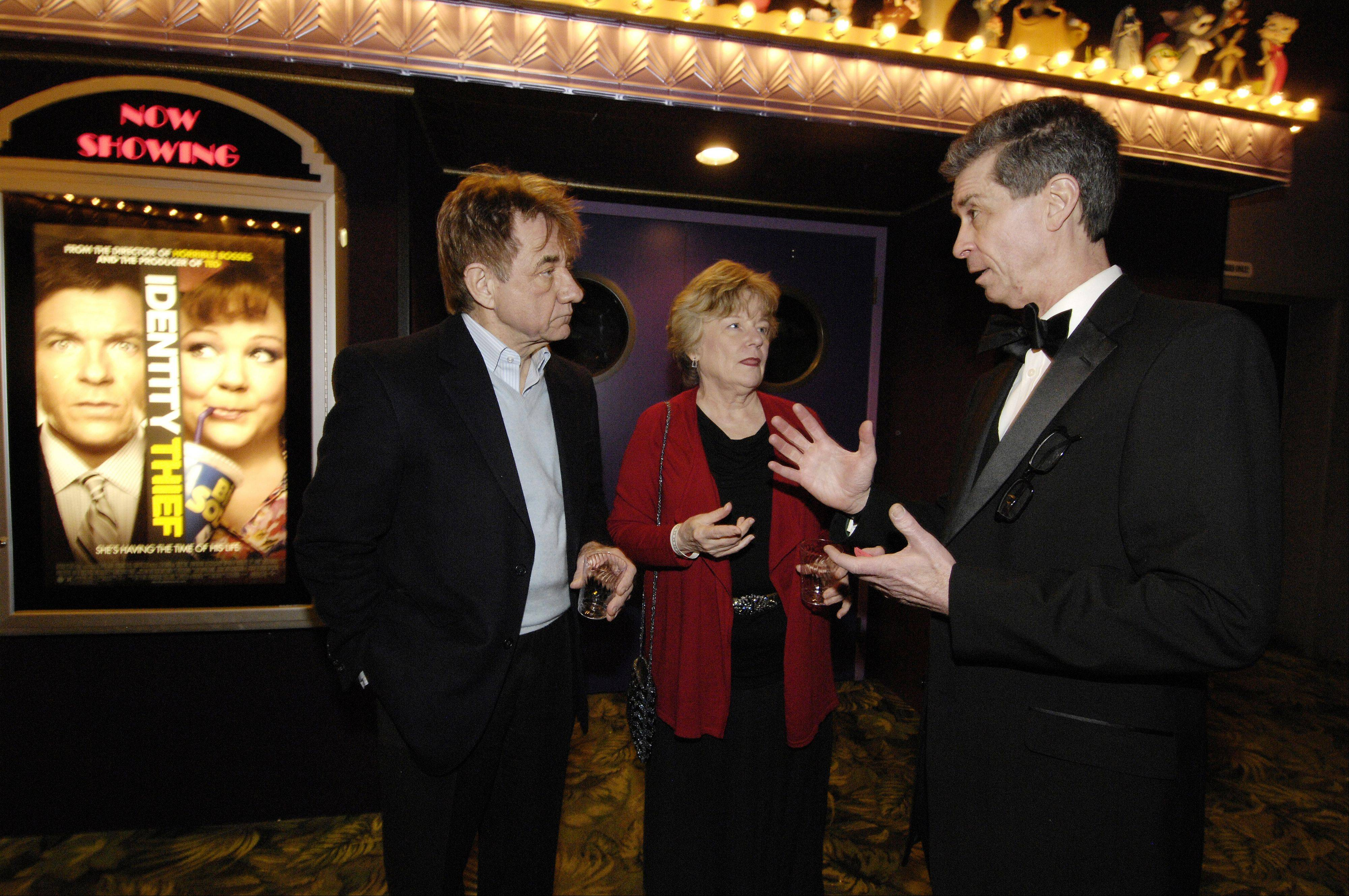 Daily Herald subscribers Bob and Patti Jostes of Arlington Heights talk with Daily Herald Film Critic Dann Gire during an Academy Awards event at the Hollywood Palms Cinema in Naperville, Sunday.