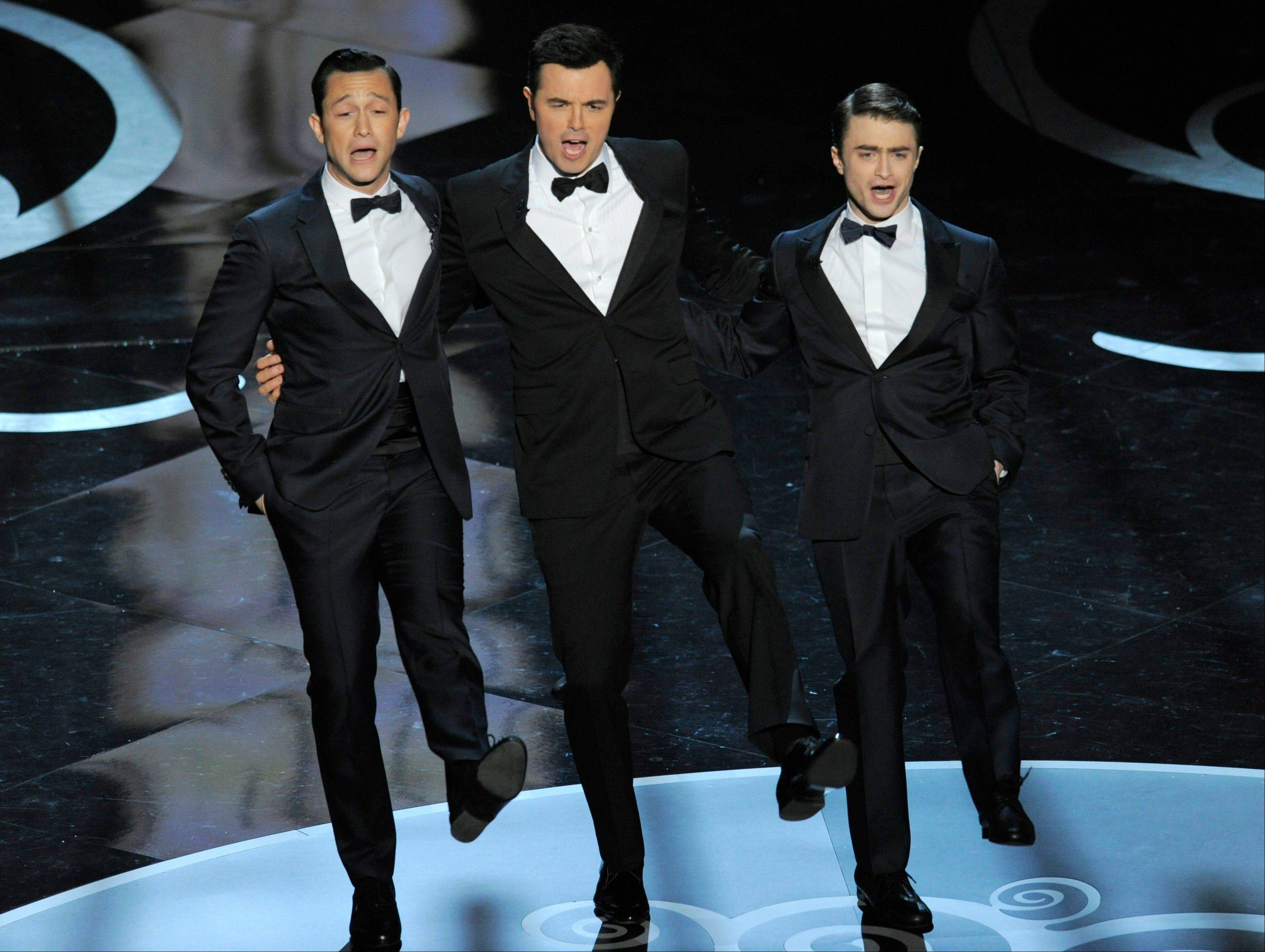 Actors, from left, Joseph Gordon-Levitt, host Seth MacFarlane and Daniel Radcliffe perform during the Oscars at the Dolby Theatre on Sunday Feb. 24, 2013, in Los Angeles.