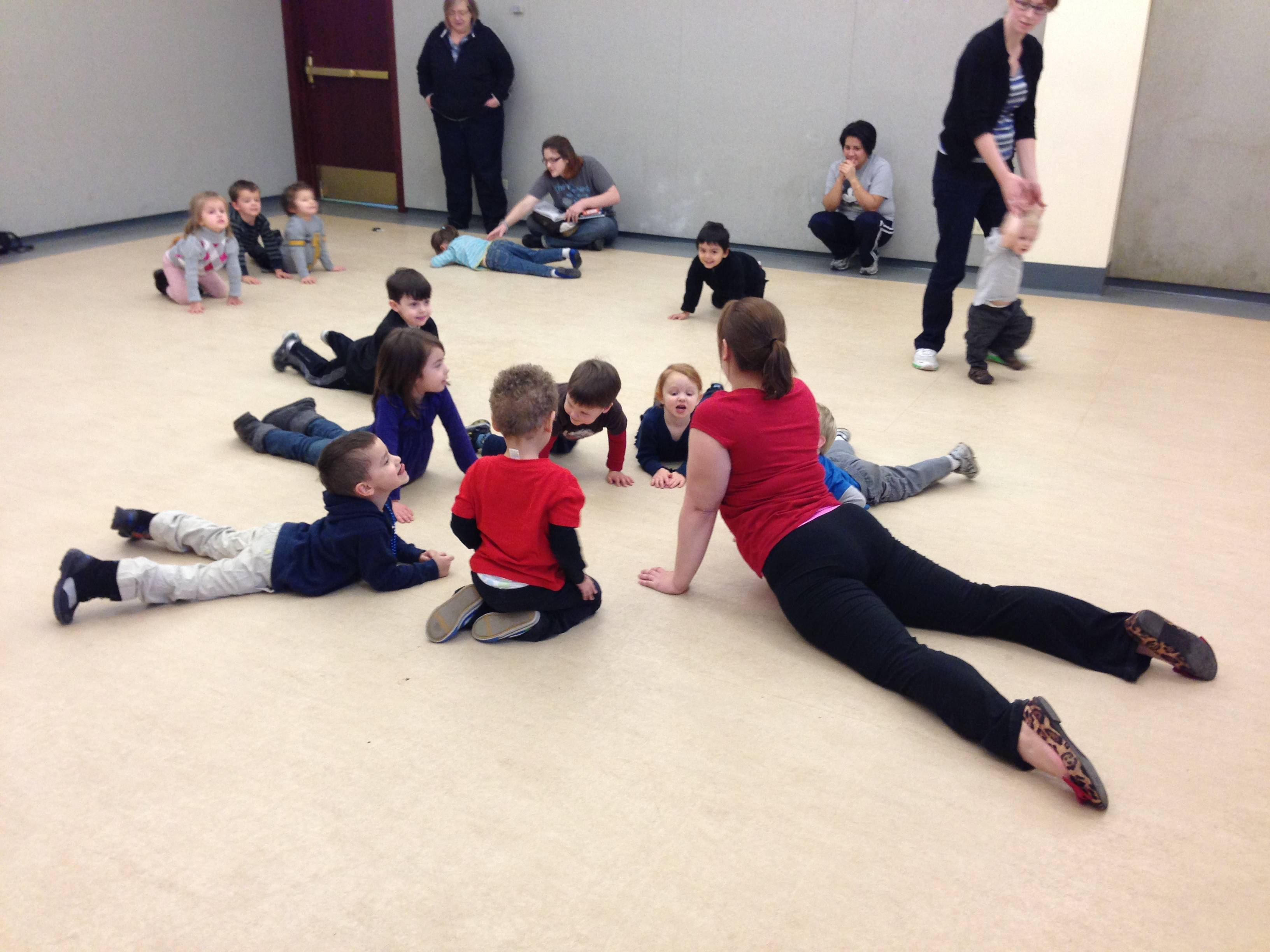 "A ""Tottercize"" session at the West Chicago Public Library District engages young children and their care givers in exercise, yoga, and healthy living."