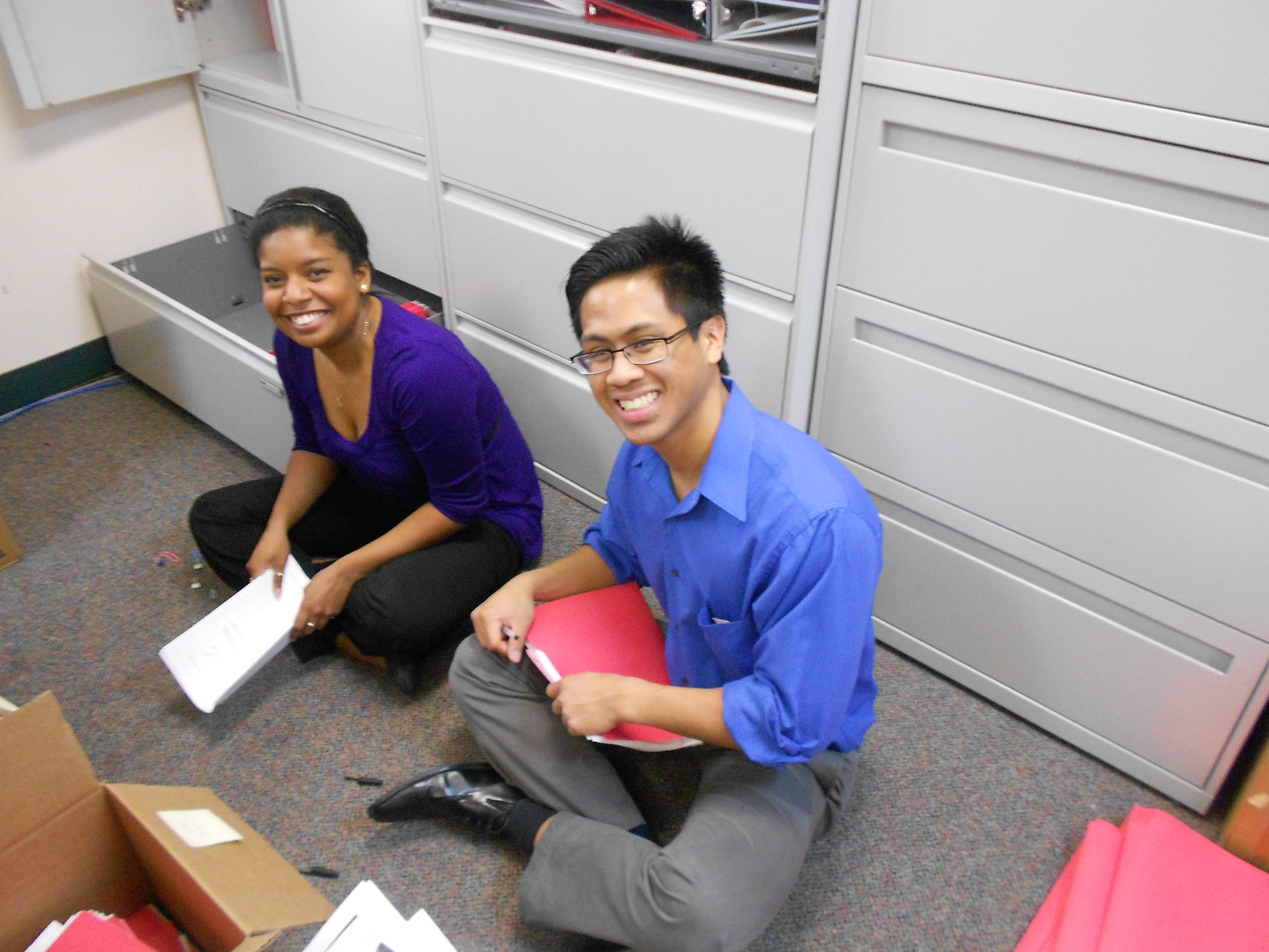 Two HSP interns Lianne Dottin (left) and Eric Domingo (right) busy at work during their internships last summer.
