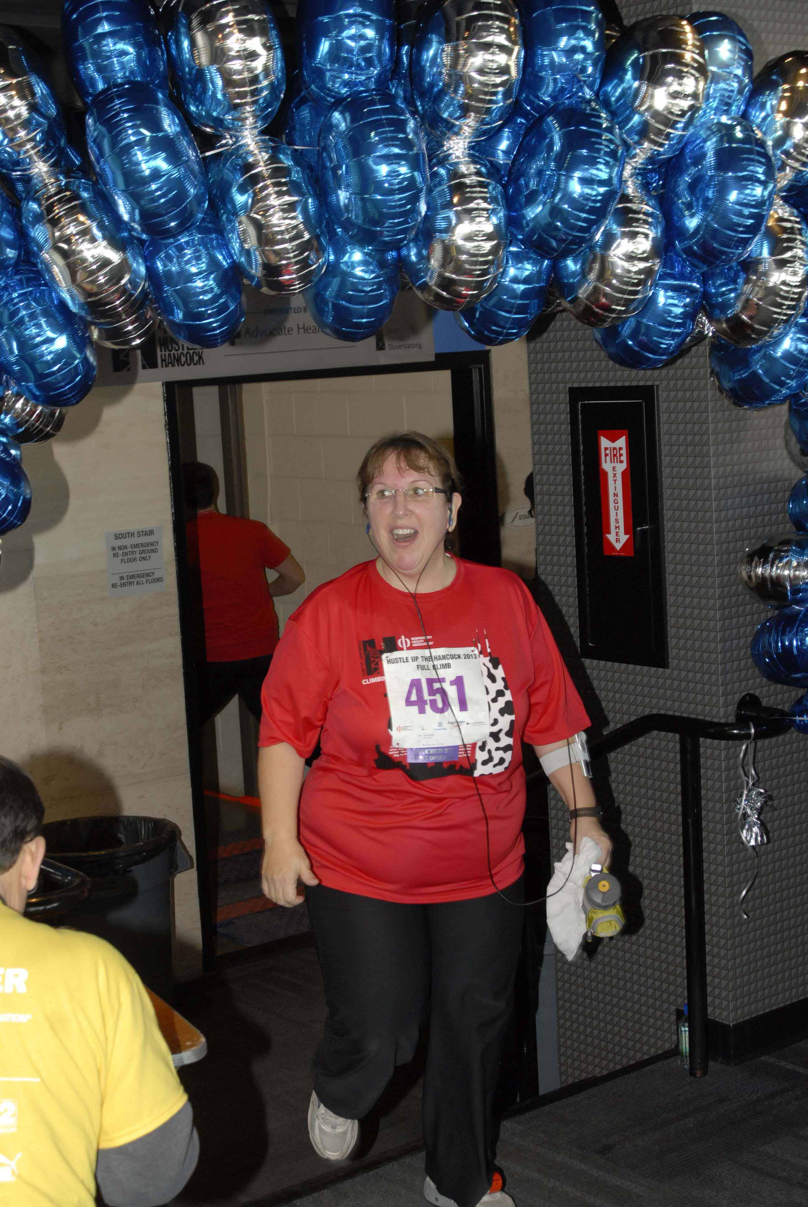 Cindy Kuffel crossing under the finish line on the 94th floor of the Hancock. Beating her time of last year by 15 minutes