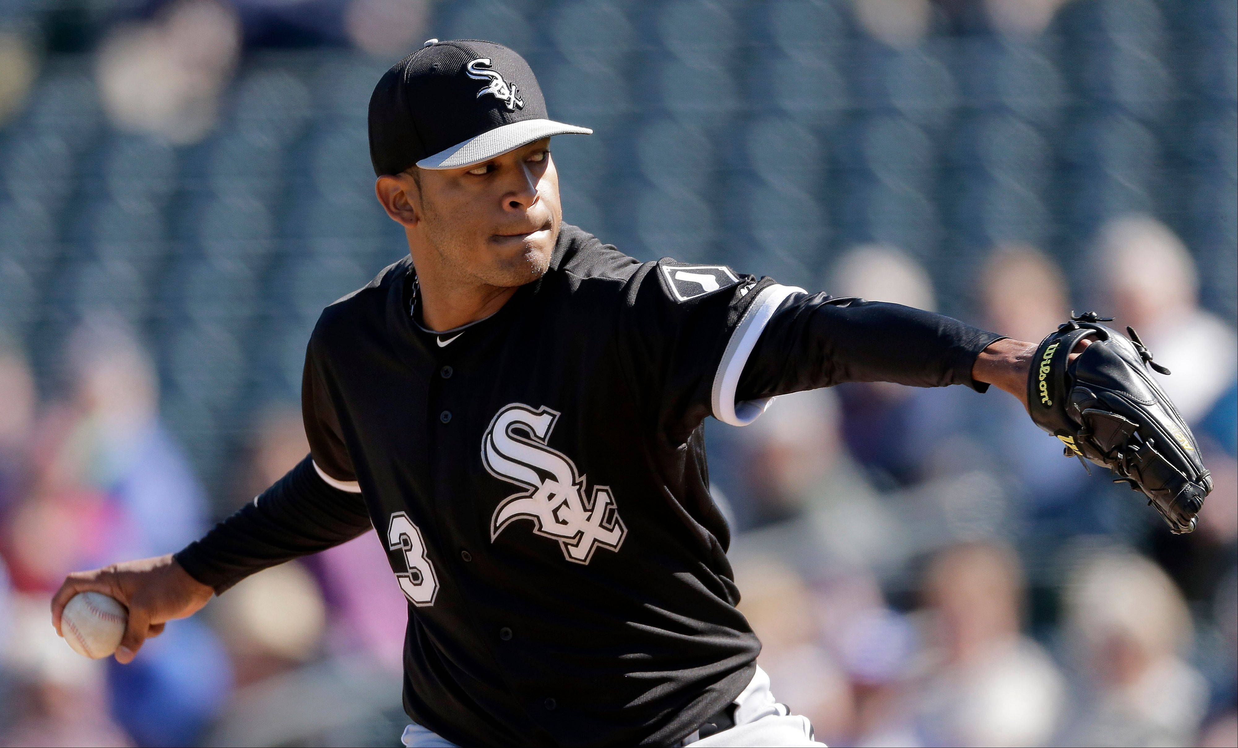 Chicago White Sox starting pitcher Nestor Molina throws during a spring training baseball game against the Texas Rangers on Tuesday, Feb. 26, 2013, in Surprise, Ariz. (AP Photo/Charlie Riedel)