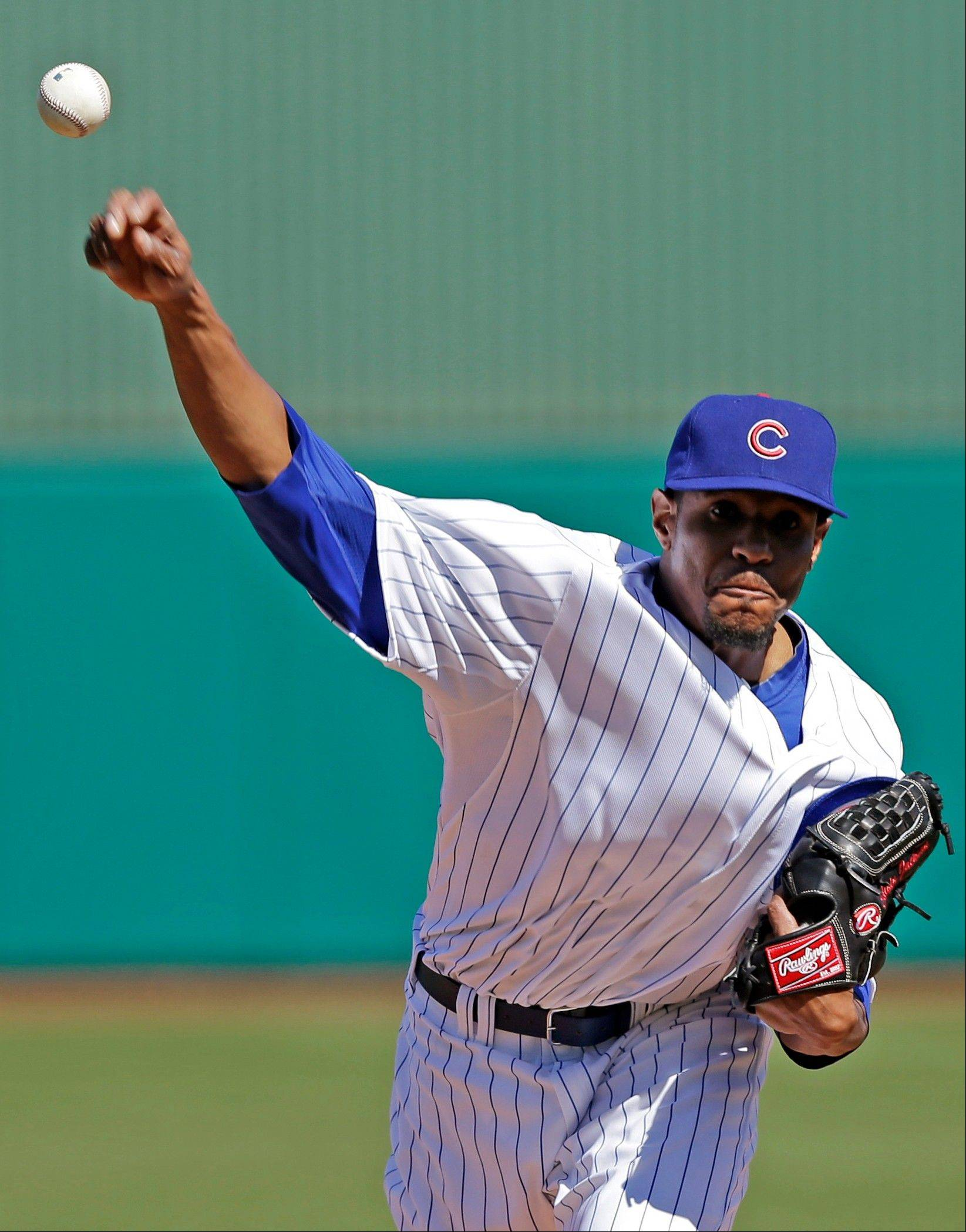 Chicago Cubs starting pitcher Edwin Jackson throws before the first inning of an exhibition spring training baseball game against the Colorado Rockies, Tuesday, Feb. 26, 2013, in Phoenix. (AP Photo/Morry Gash)