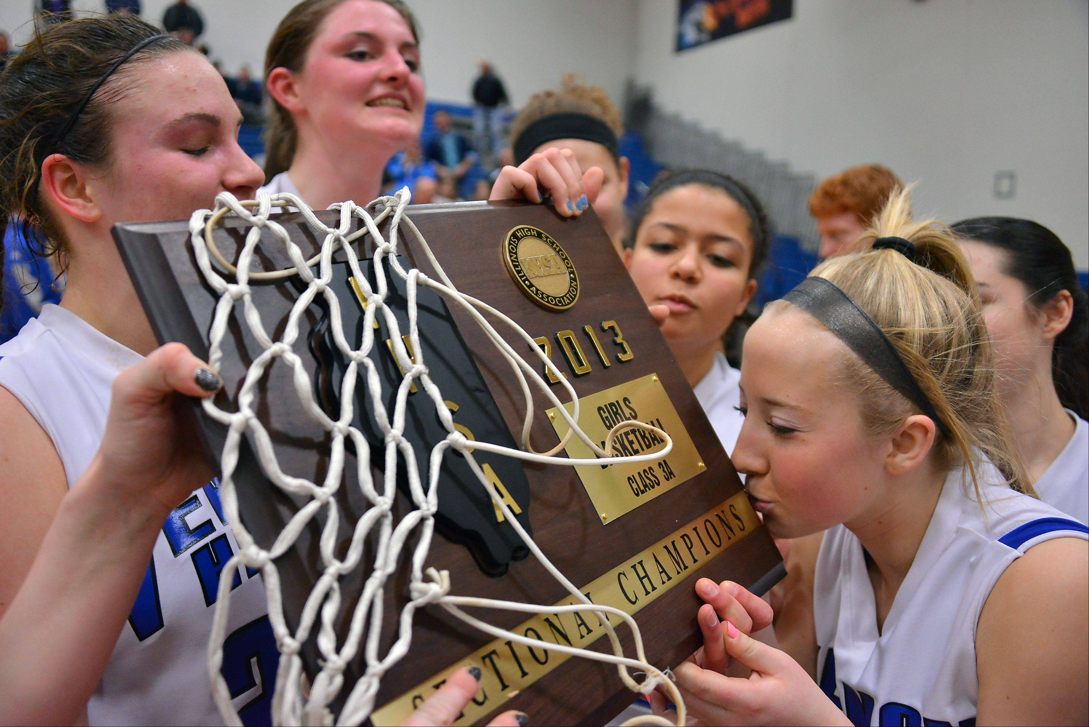 Vernon Hills� Haley Lieberman kisses the championship plaque after the Cougars defeated Regina Dominican in the Class 3A sectional final in Vernon Hills.
