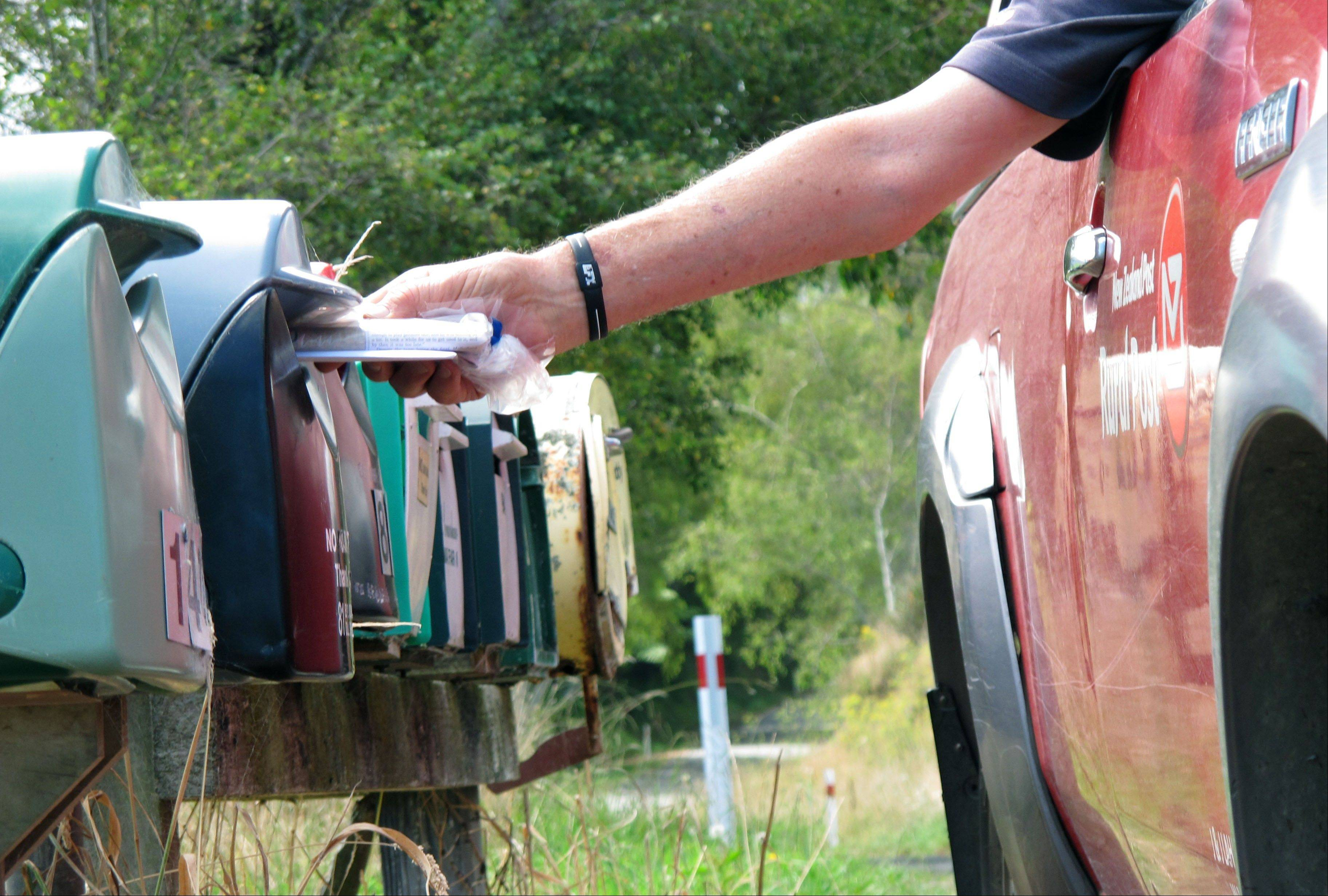 Associated PressPostman John Lahmert delivers mail in rural Otaki, New Zealand. New Zealand is considering cutting letter deliveries from six days a week to three as global demand for postal services dwindles.