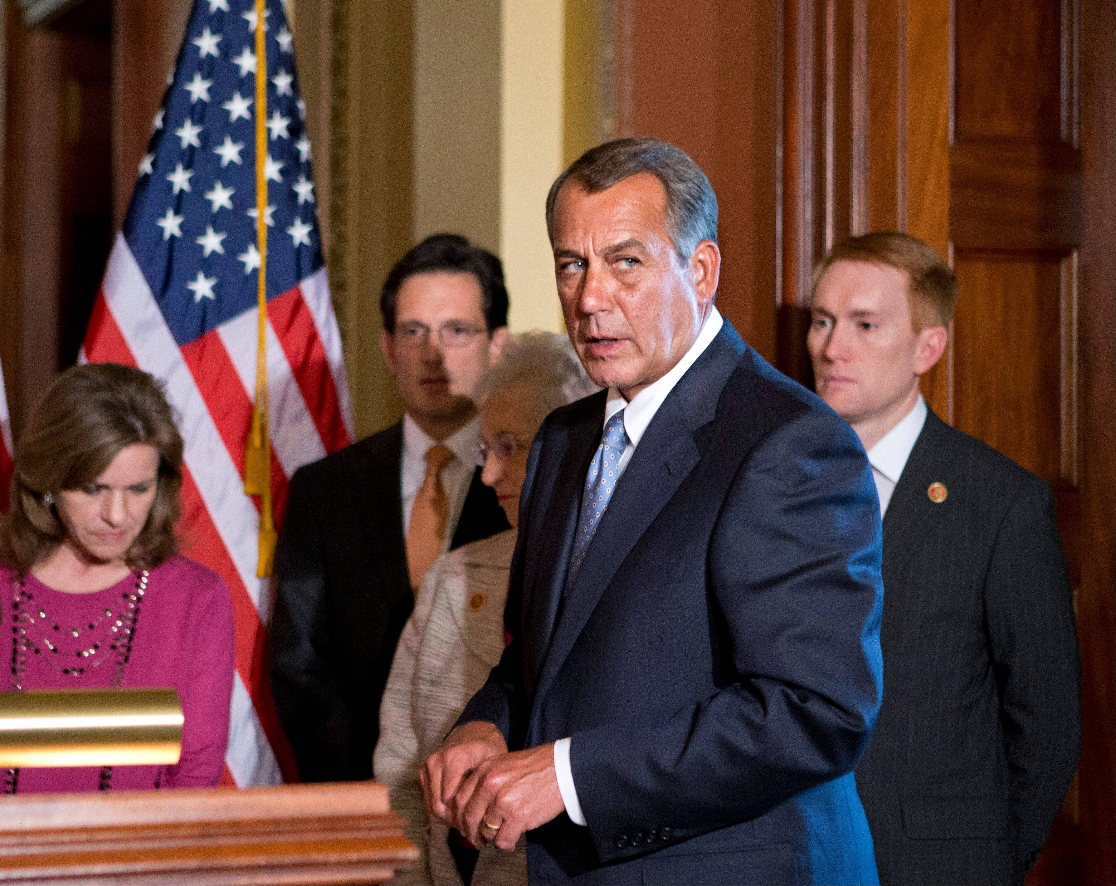 House Speaker John Boehner of Ohio, accompanied by fellow members of the House GOP leadership, responds to President Barack Obama's remarks to the nation's governors about how to fend off the impending automatic budget cuts.