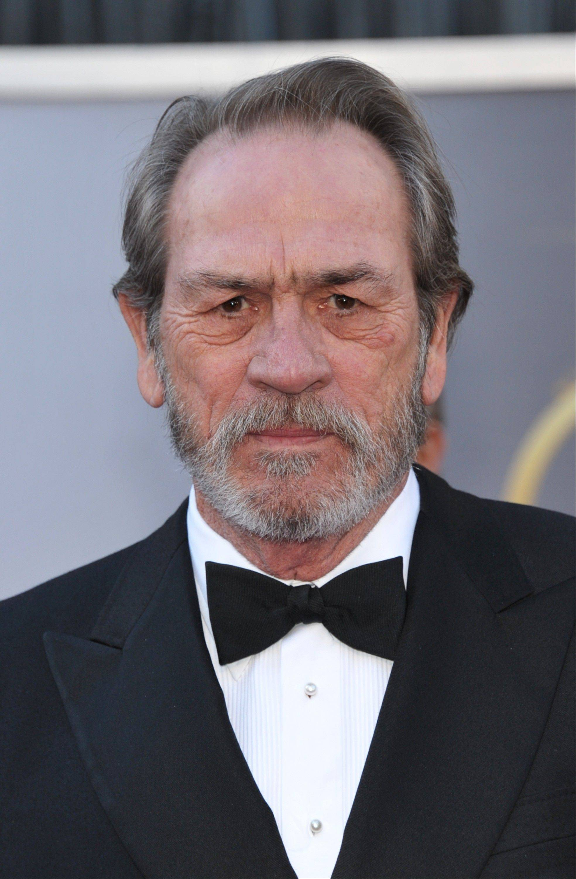 Obviously thrilled with just being nominated for an Oscar, actor Tommy Lee Jones arrives at the Dolby Theatre on Sunday.