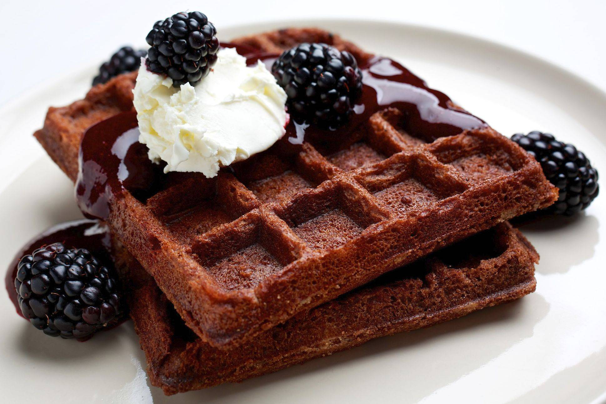 These fragrant Chocolate Brownie Waffles With Blackberry Sauce come together quickly.