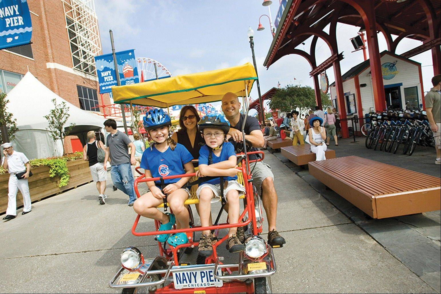 The busier you get in the city, the more you may want to travel by wheel, like this family taking a quadcycle from Bike and Roll Chicago through Navy Pier.