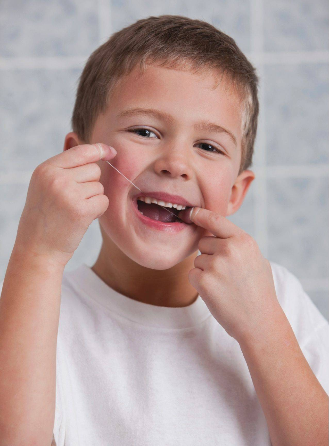 Children should learn that flossing is just as important as brushing.