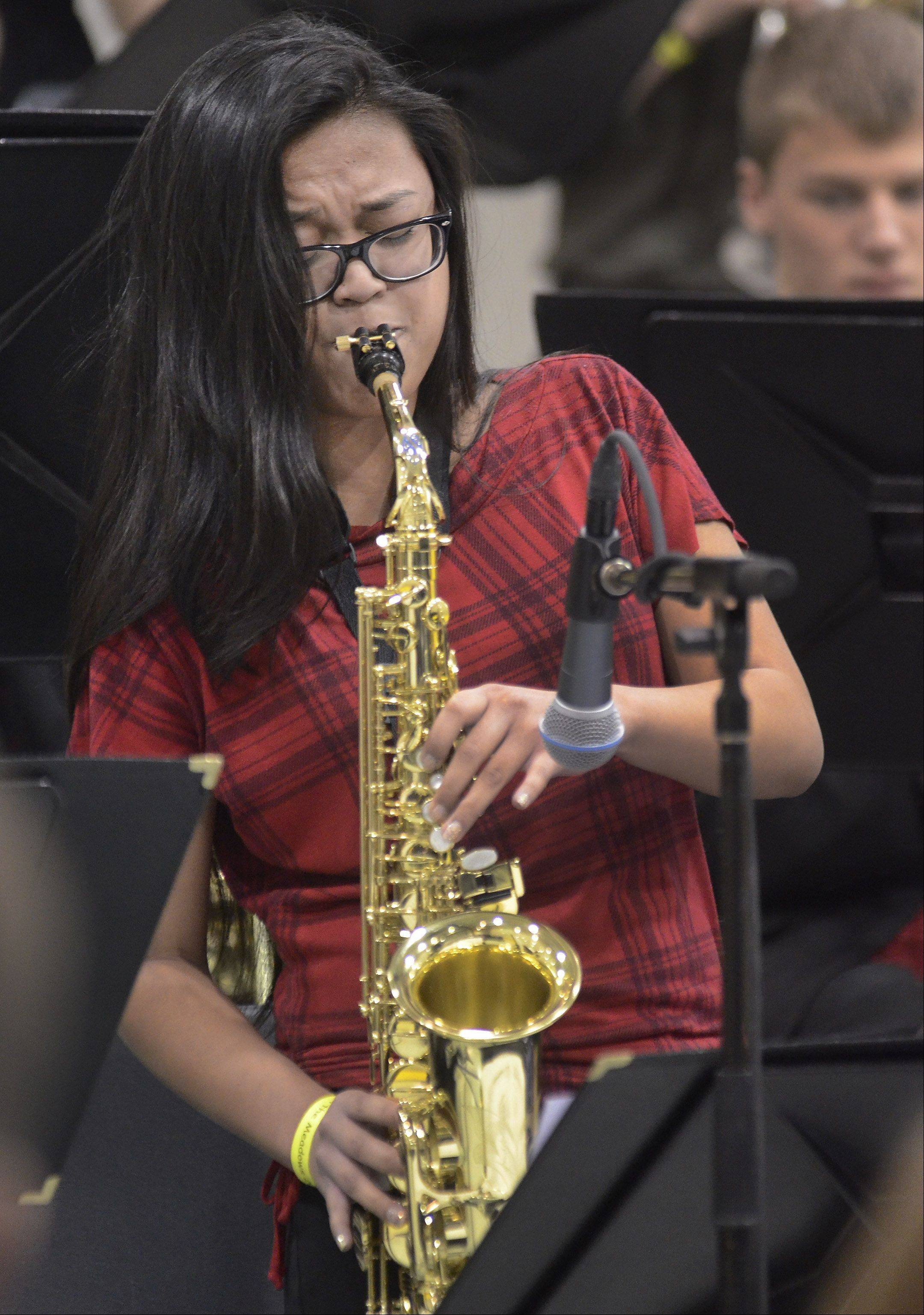 "Danica Vendiola solos on alto sax for the Mundelein High School Jazz Ensemble during their rendition of ""Tip Toe."""