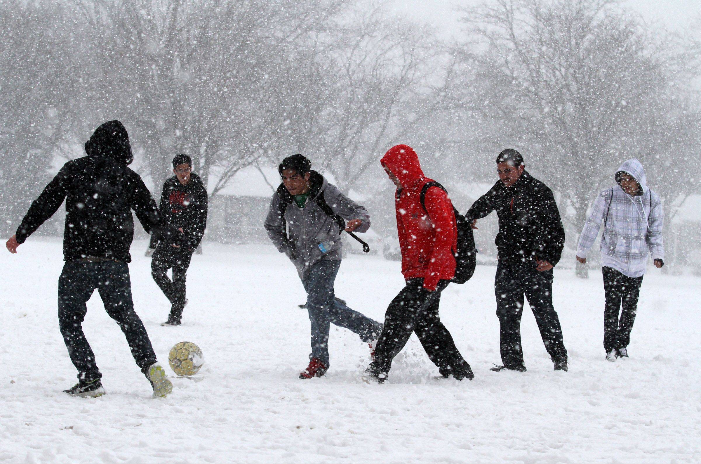 A group of Elk Grove High School students play soccer during their lunch break in Elk Grove Village on Tuesday, February 26, 2013.2