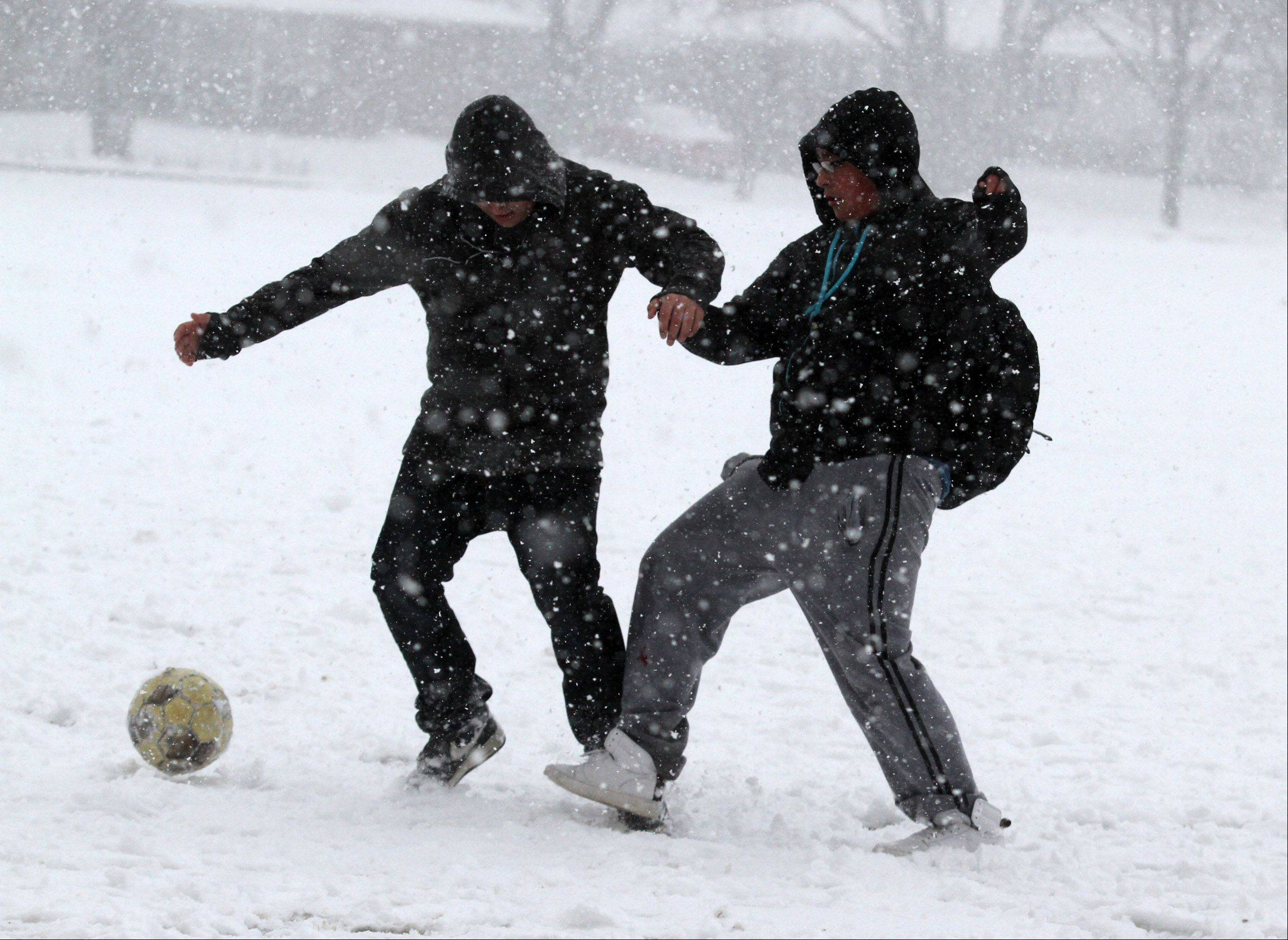 Erik Puentes, right, and another Elk Grove High School student play soccer during their lunch break in Elk Grove Village on Tuesday, February 26, 2013.