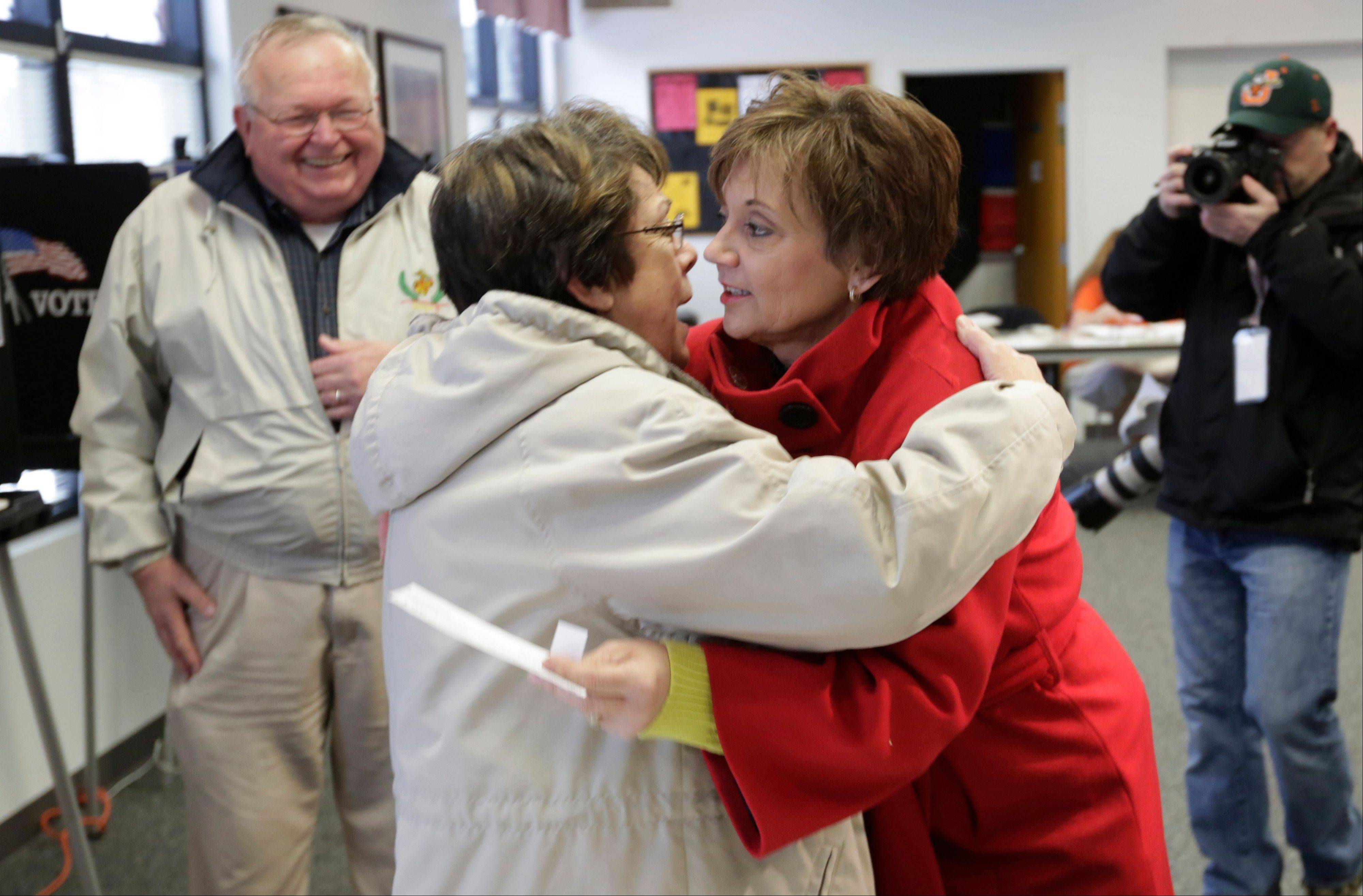 Former Democratic U.S. Rep. Debbie Halvorson hugs friend Rita Mulvihill as they casts their votes in Steger on Tuesday.