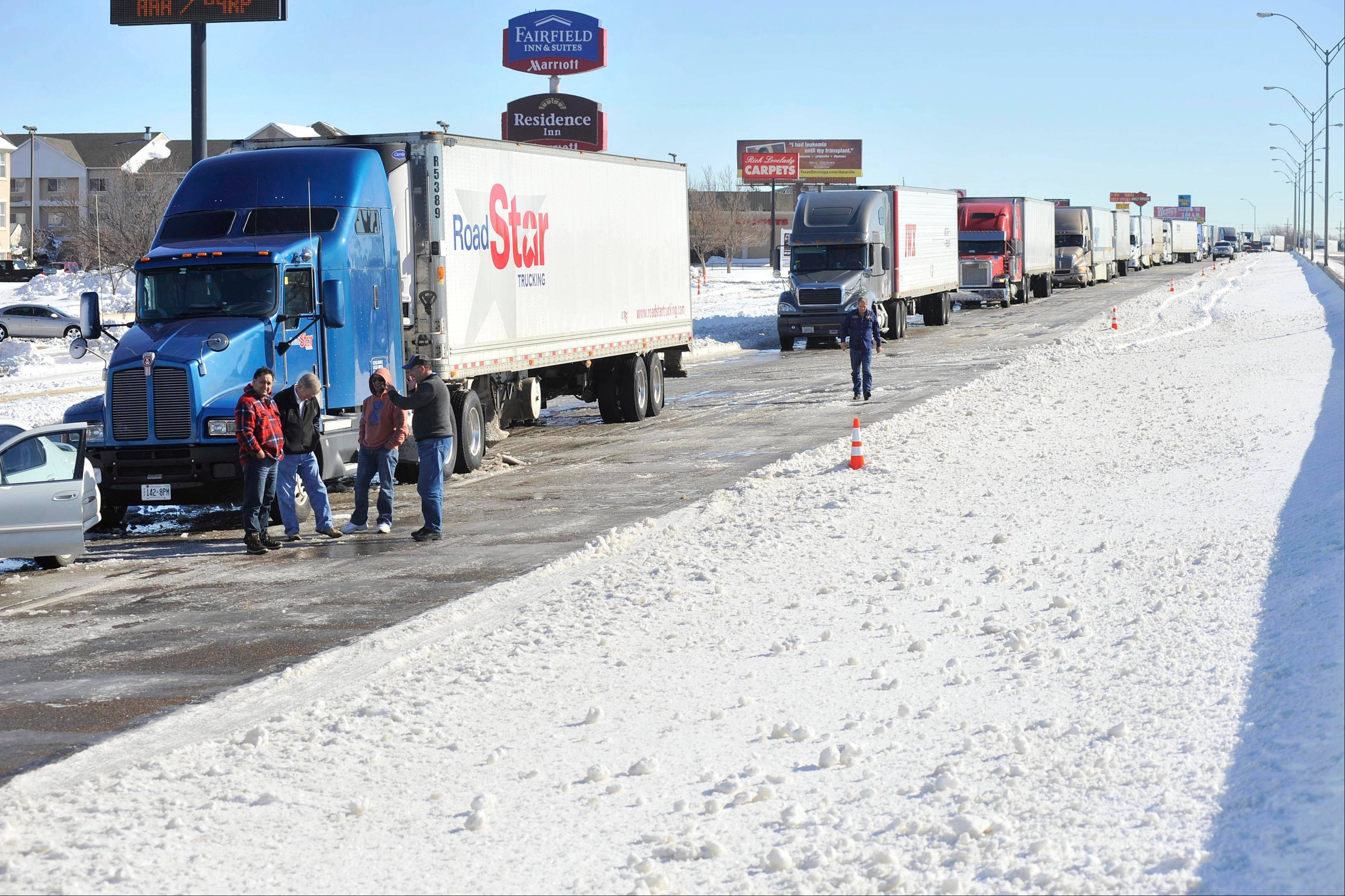 Traffic is at a complete standstill waiting for the highway to reopen on Tuesday in Amarillo, Texas. I-40 westbound was reopened and traffic began moving at noon. The blizzard that hammered the nation's midsection broke a 120-year-old record in Amarillo for one-day snowfall in February with 19.1 inches.