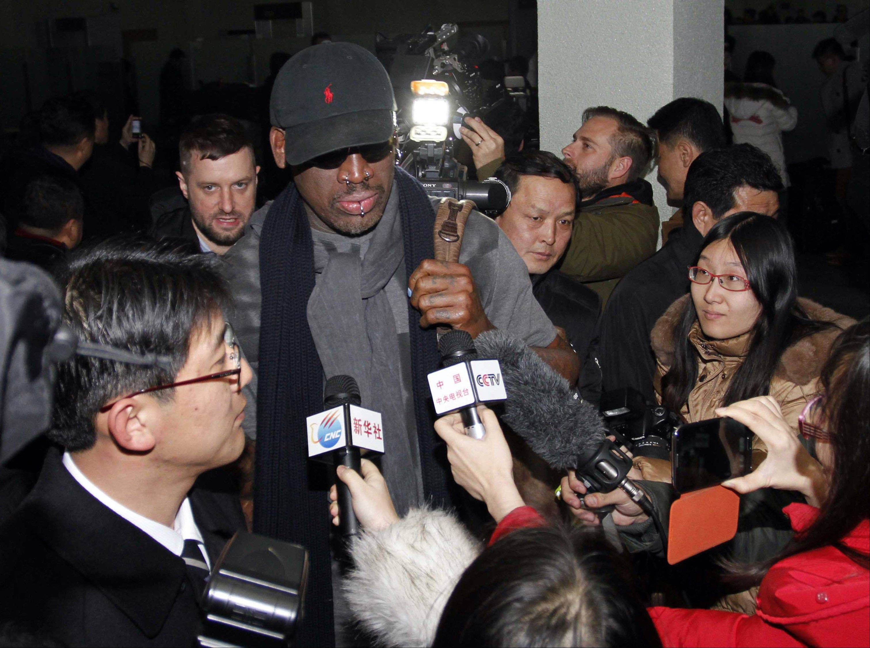 "Flamboyant former NBA star Dennis Rodman is surrounded by journalists upon arrival at Pyongyang Airport, North Korea, Tuesday. The American known as ""The Worm"" arrived in Pyongyang, becoming an unlikely ambassador for sports diplomacy at a time of heightened tensions between the U.S. and North Korea."