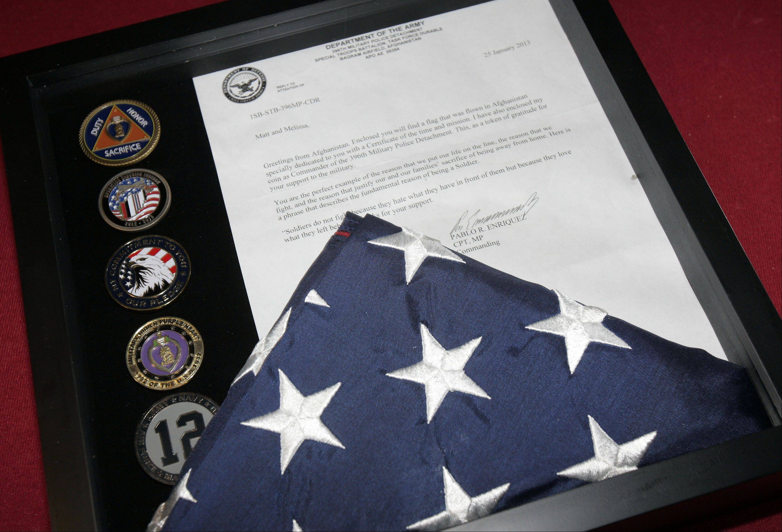 Matt Steichen of St. Charles received a flag from one of the wounded veterans he and his dad took with them to a game.