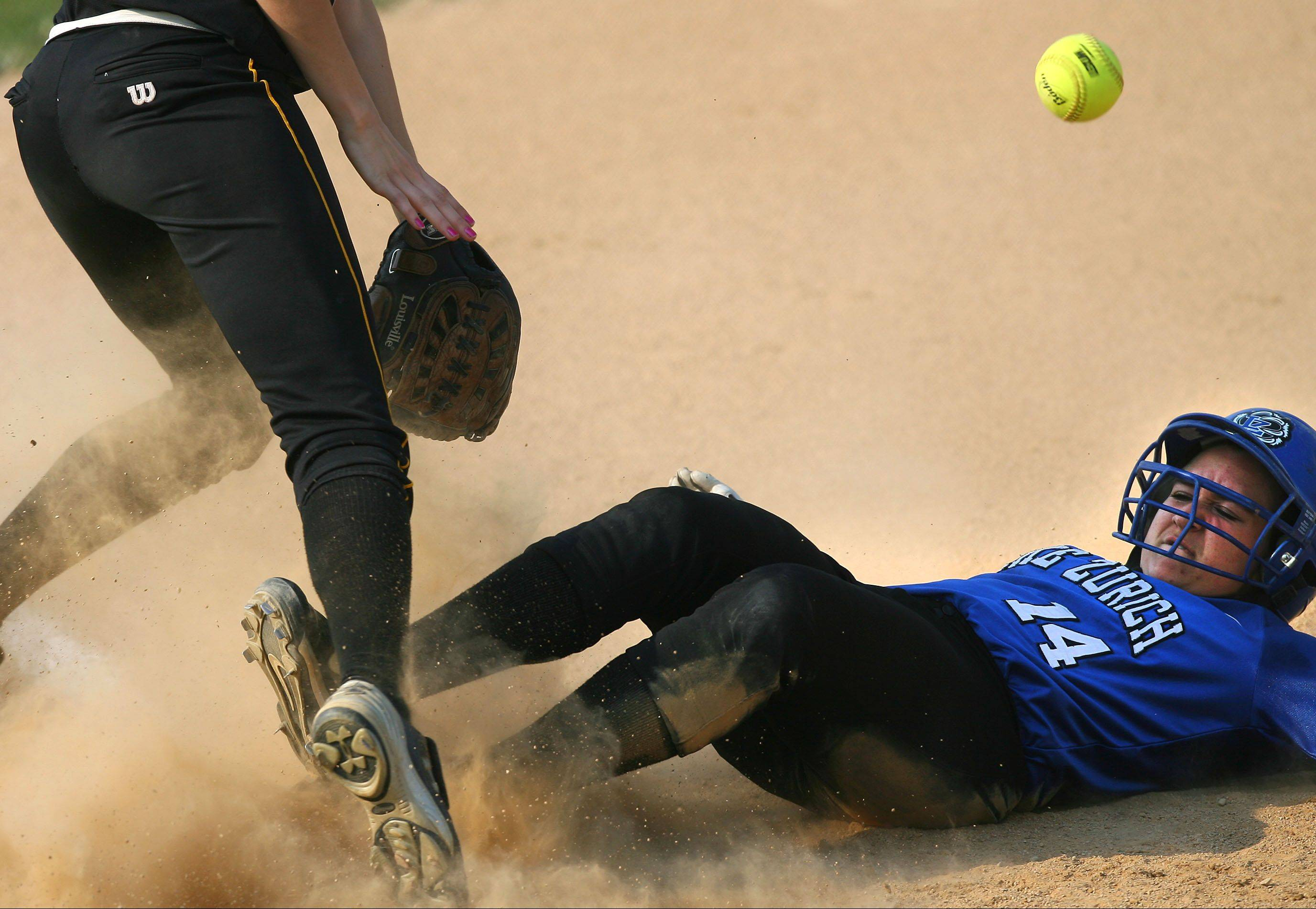 Lake Zurich's Maria Schroeder slides safely into third base last season against Stevenson.