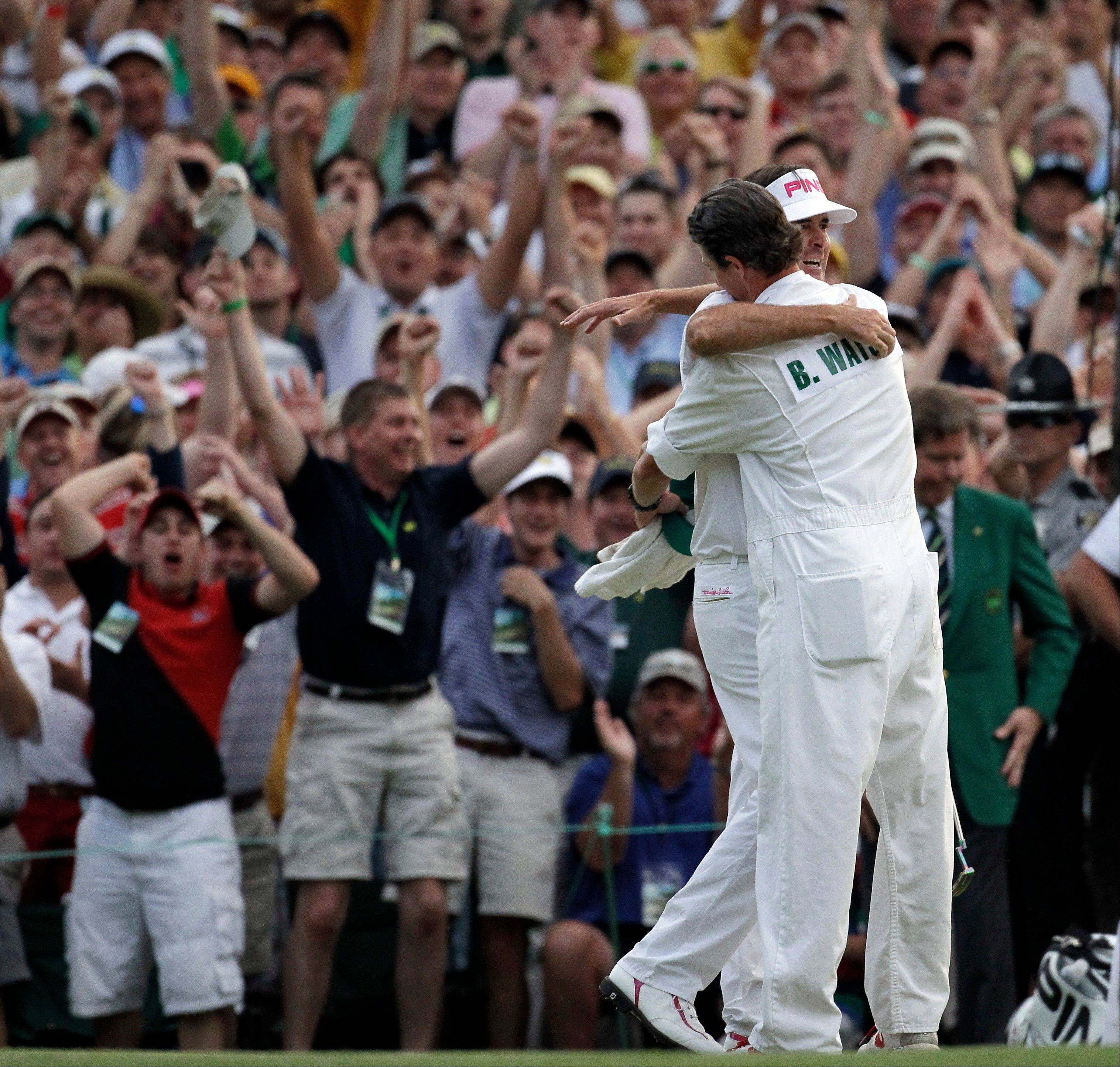 Bubba Watson, here hugging his caddie Ted Scott after winning the Masters golf tournament last April, never forgot the wager he made with Webb Simpson's caddie.