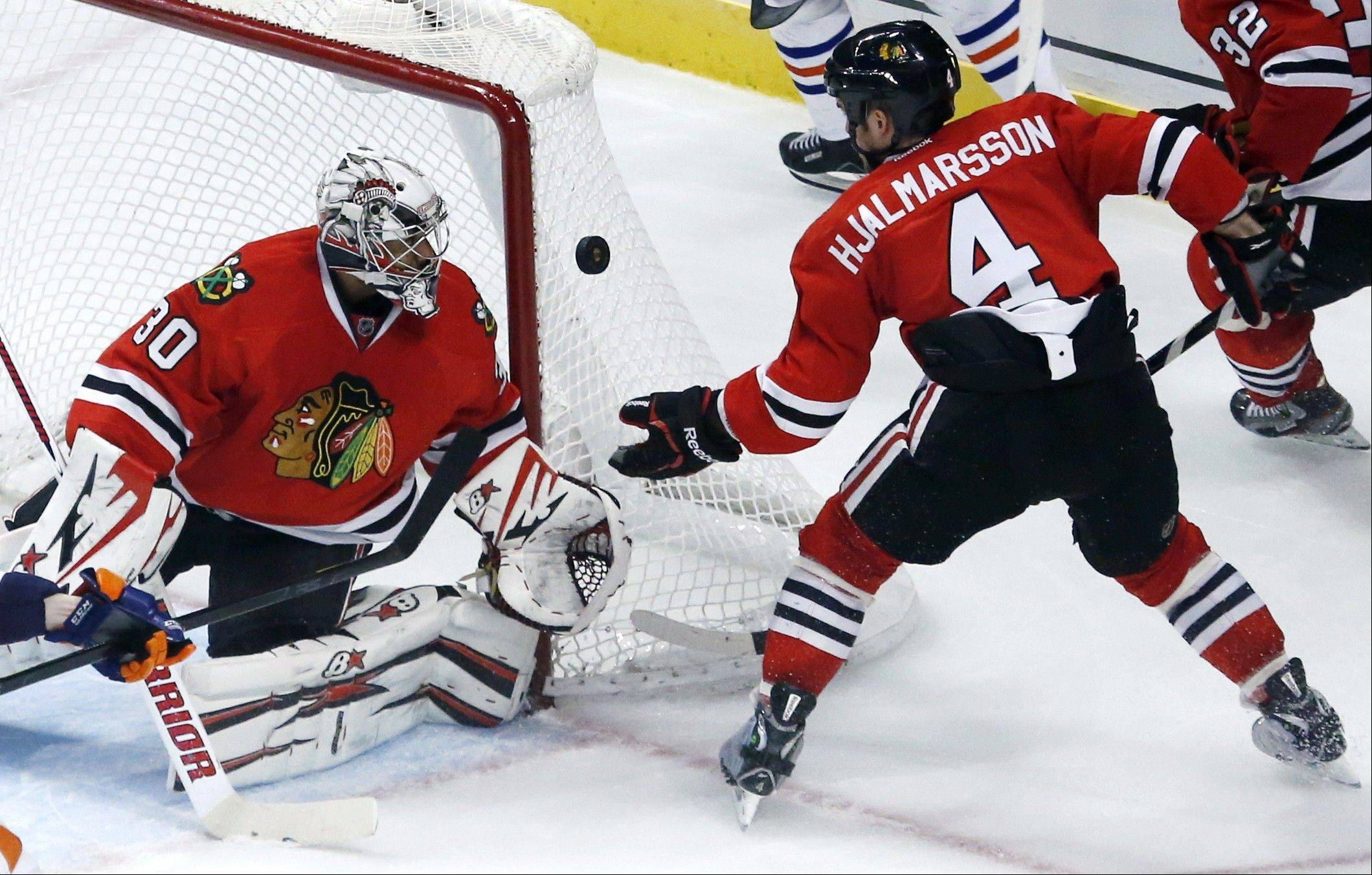Chicago Blackhawks defenseman Niklas Hjalmarsson clears the puck after goalie Ray Emery made a save during the third period.