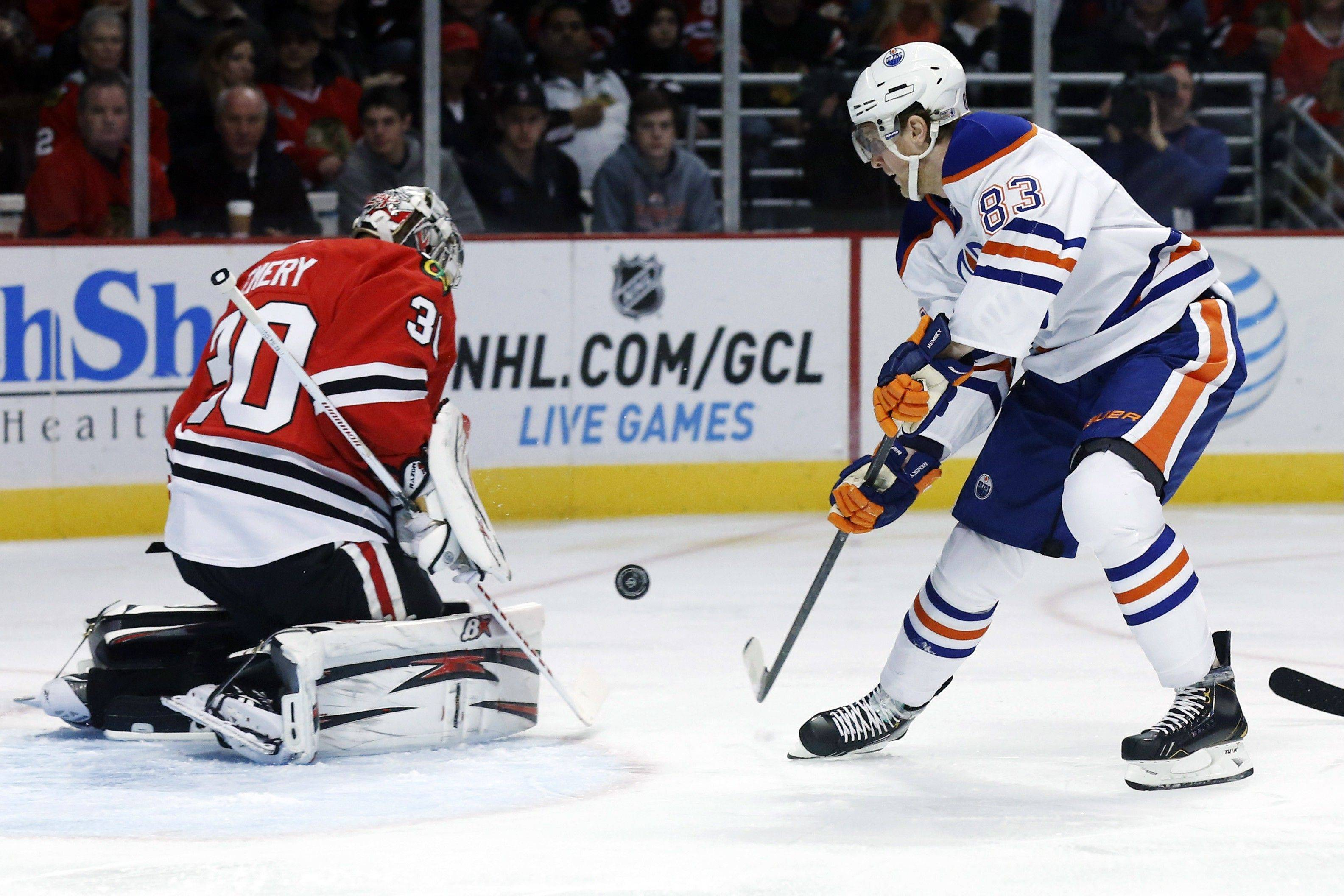 Chicago Blackhawks goalie Ray Emery makes a save on a shot by Edmonton Oilers right wing Ales Hemsky during the first period.