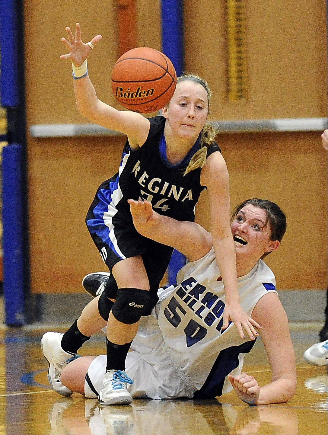Vernon Hills' Meri Bennett-Swanson battles for a loose ball with Regina Dominican's Erin Gavin in the Class 3A girls basketball sectional final at Vernon Hills High School on Thursday.