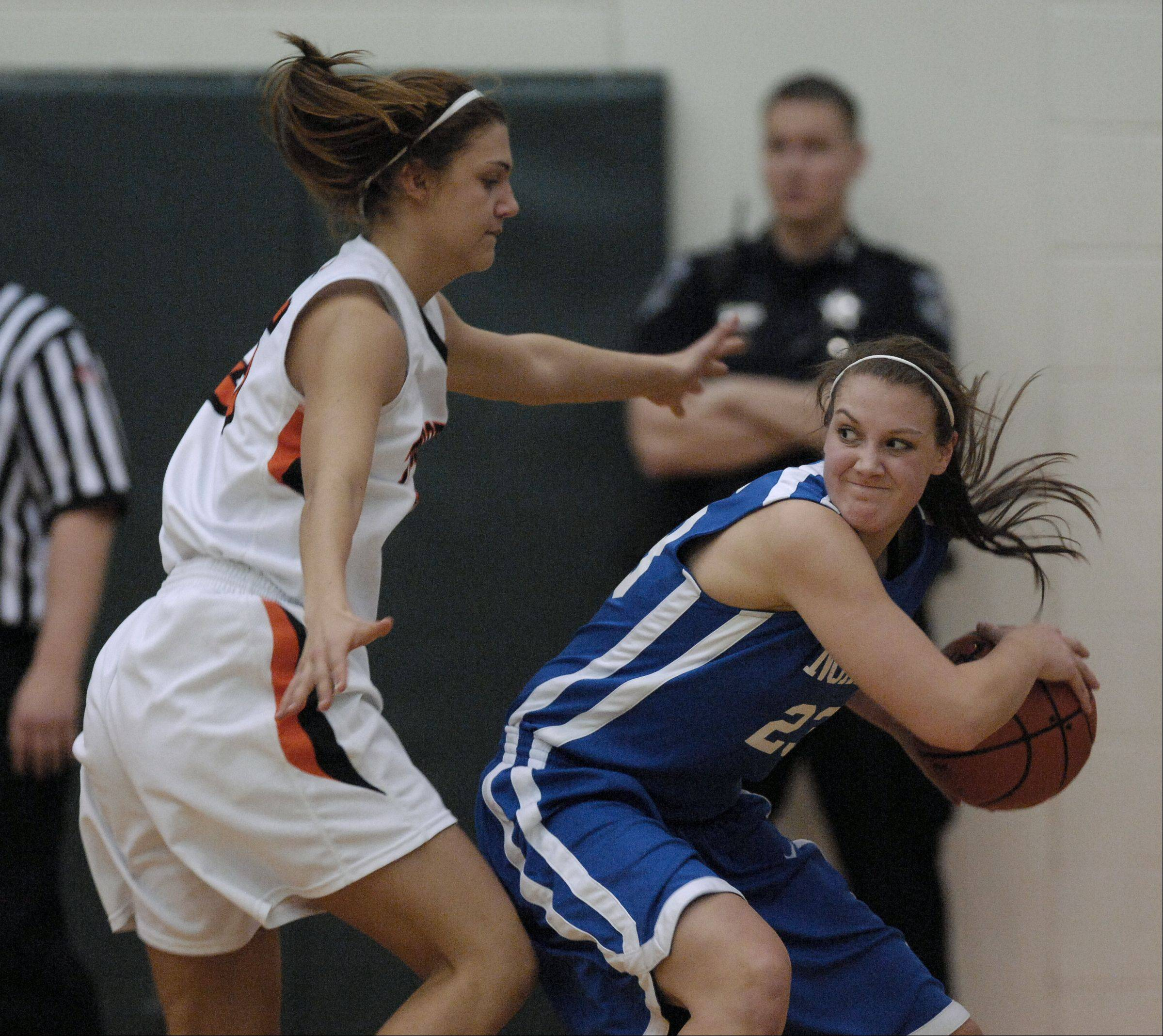 Wheaton Warrenville South's Alyssa Zappia guards Wheaton North's Chrissy Baird Thursday during the Class 4A girls basketball sectional final at Bartlett High School.
