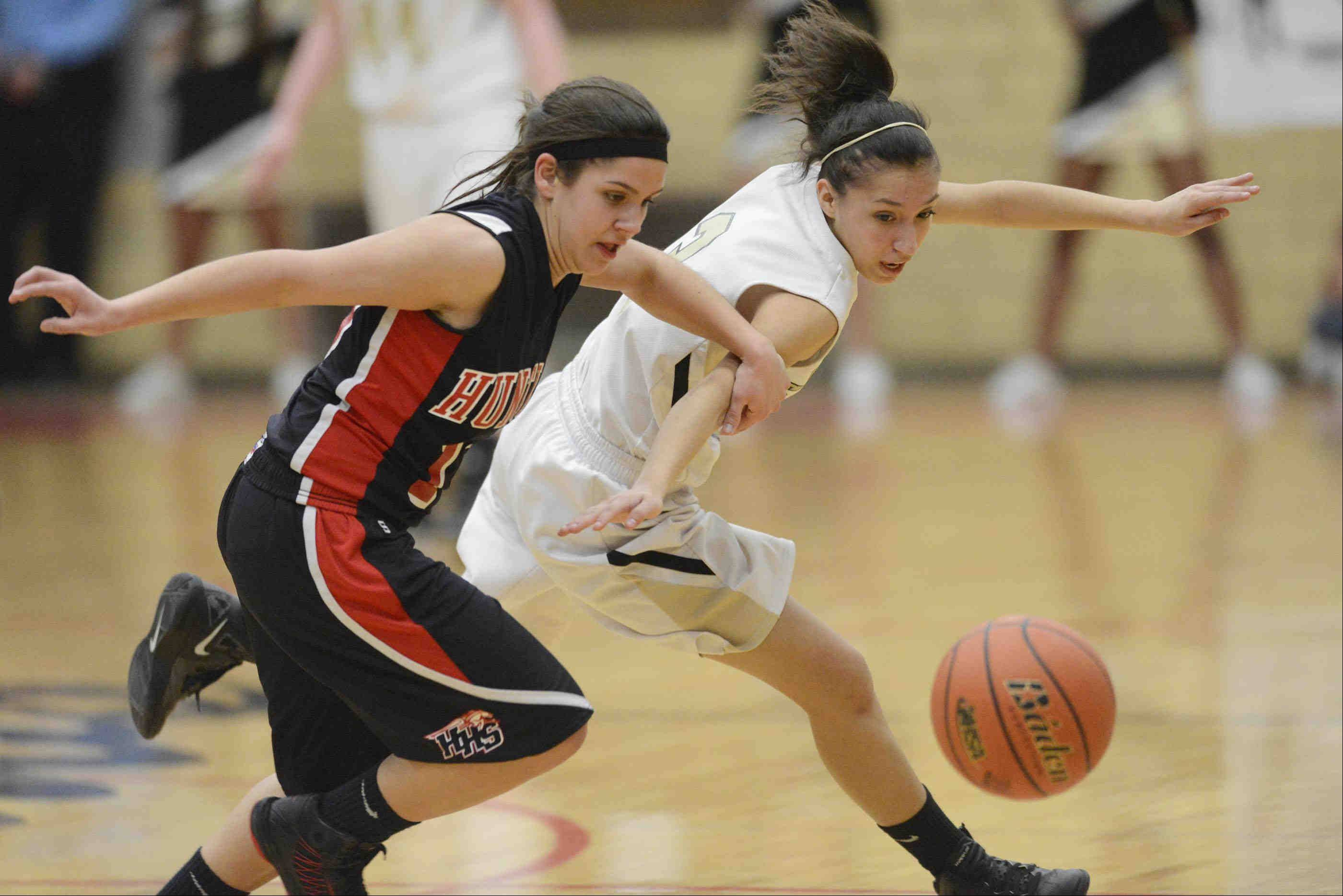 Streamwood's Kimberly Jimenez and Huntley's Kayla Barreto scramble for the ball in the Class 4A Rockford East sectional championship Thursday.