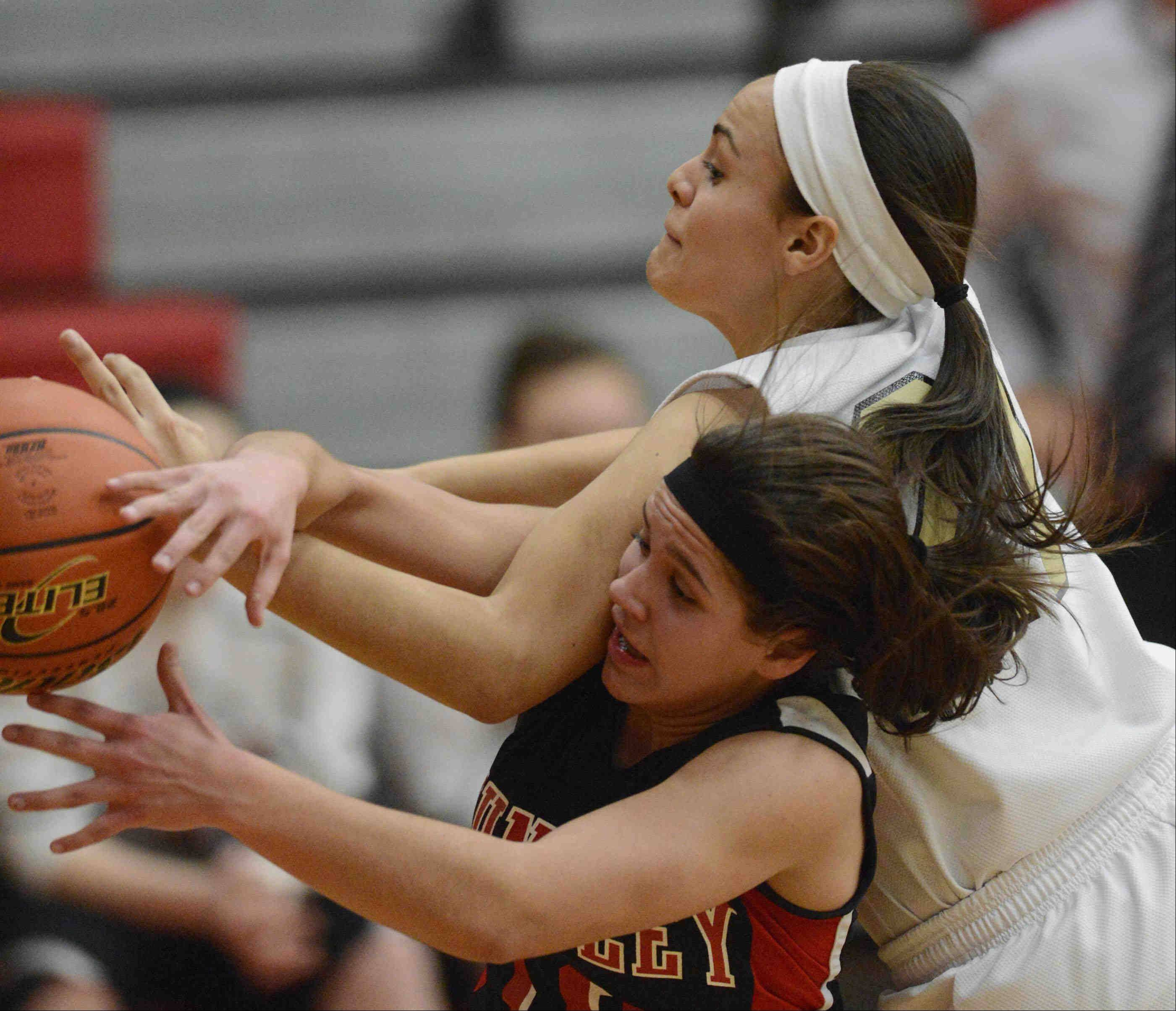 Streamwood's Brittany Delao fouls Huntley's Kayla Barreto in the Class 4A Rockford East sectional championship Thursday.