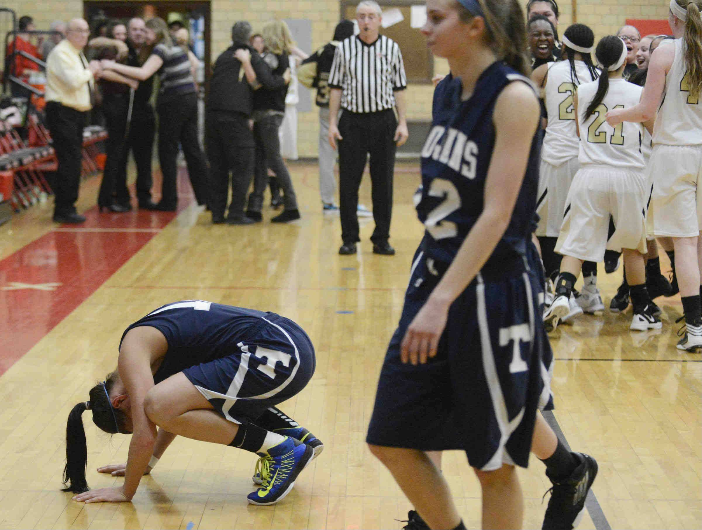 Cary-Grove's Joslyn Nicholson falls to the floor at the end of the Trojan's loss to Streamwood Monday in the Class 4A sectional game in Rockford.