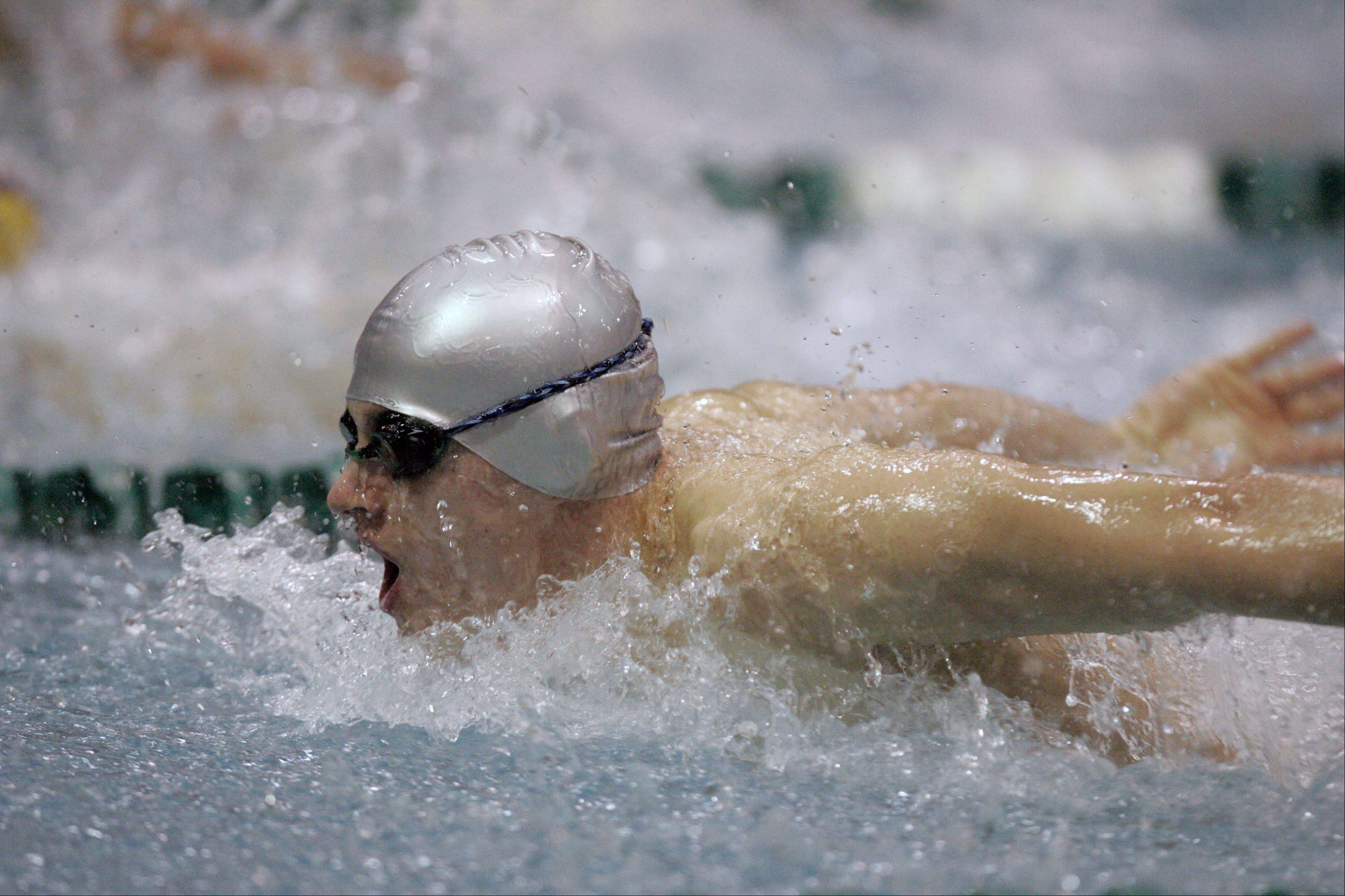Conant's Martin Pozniak competes in the 200-yard individual medley during the IHSA State Swimming prelims at New Trier High School.
