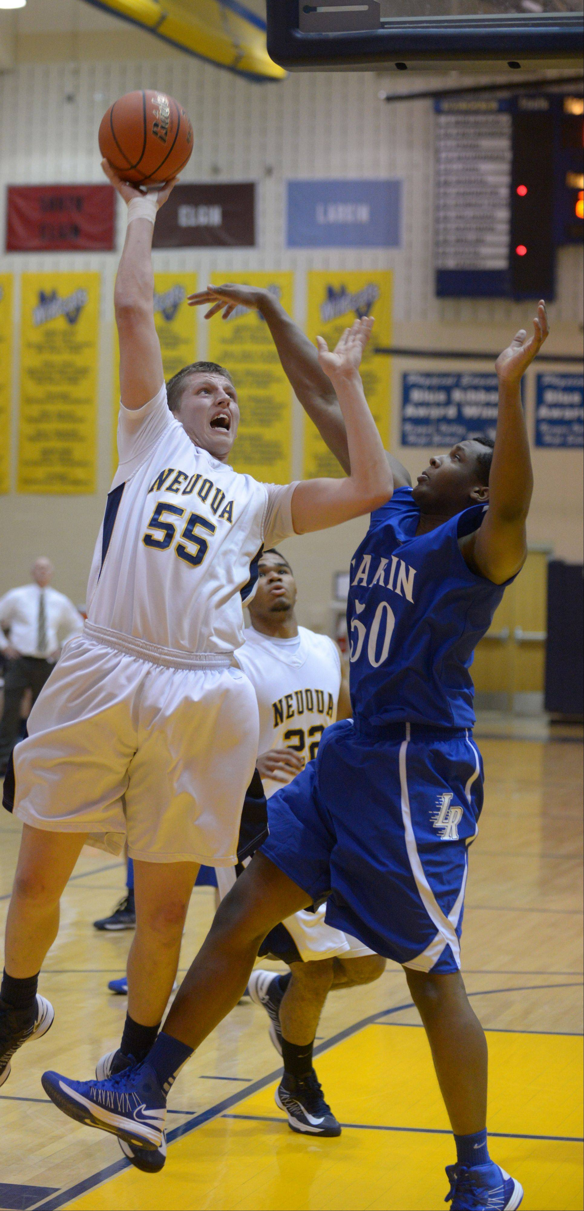 Neuqua Valley's Pat Kenny, left, takes a shot over Larkin's Daniel McFadden during Friday's game in Naperville.
