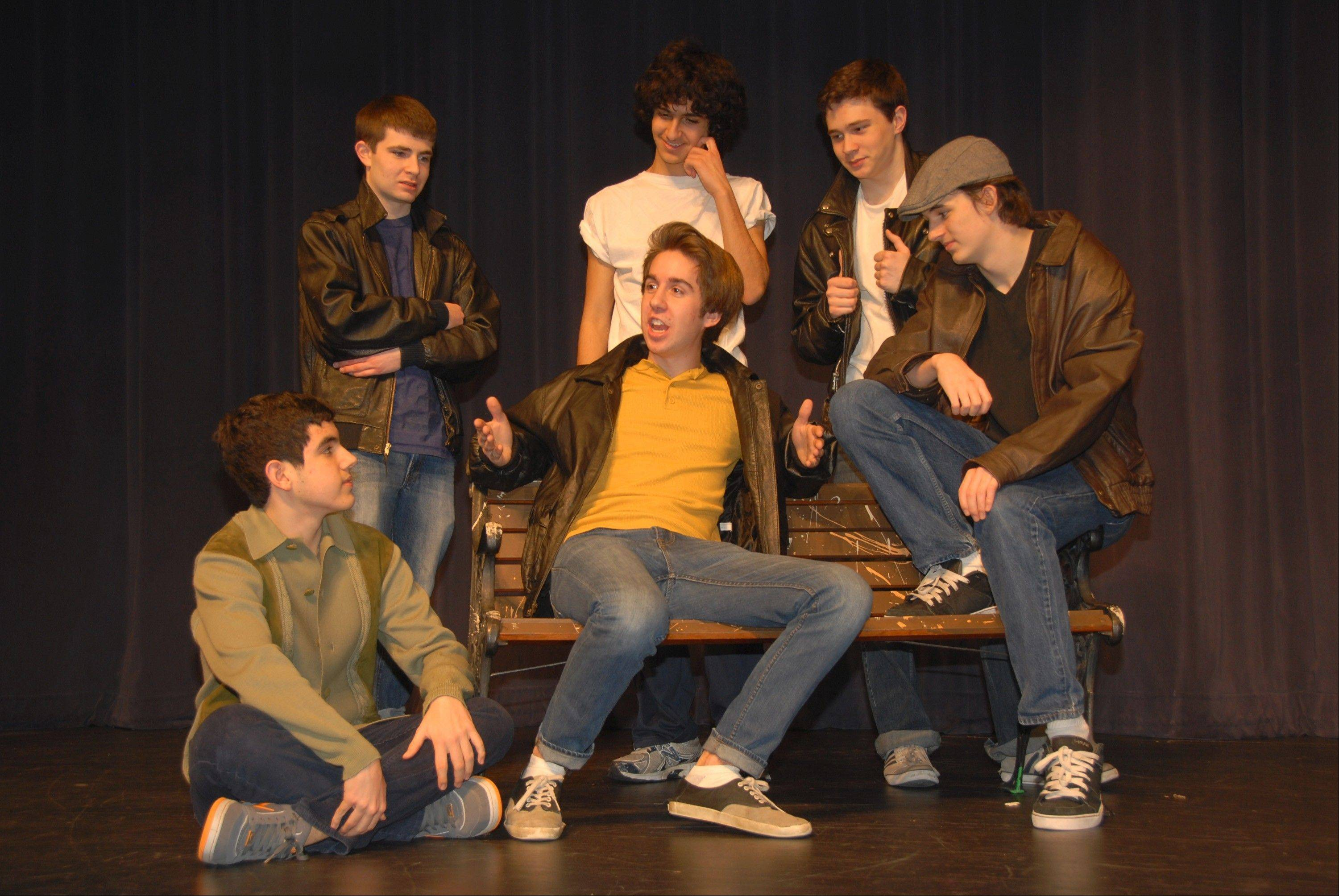 "During a rehearsal for South Elgin High School's musical, ""Grease,"" Kenickie tells the guys about his new ride, ""Greased Lightning."" Front, from left, are Justin Santostefano, Bradley Smith, and Brad Wendt; second row, from left, are Brett Meyer, Daniel Mikhail and Joseph Beaty."