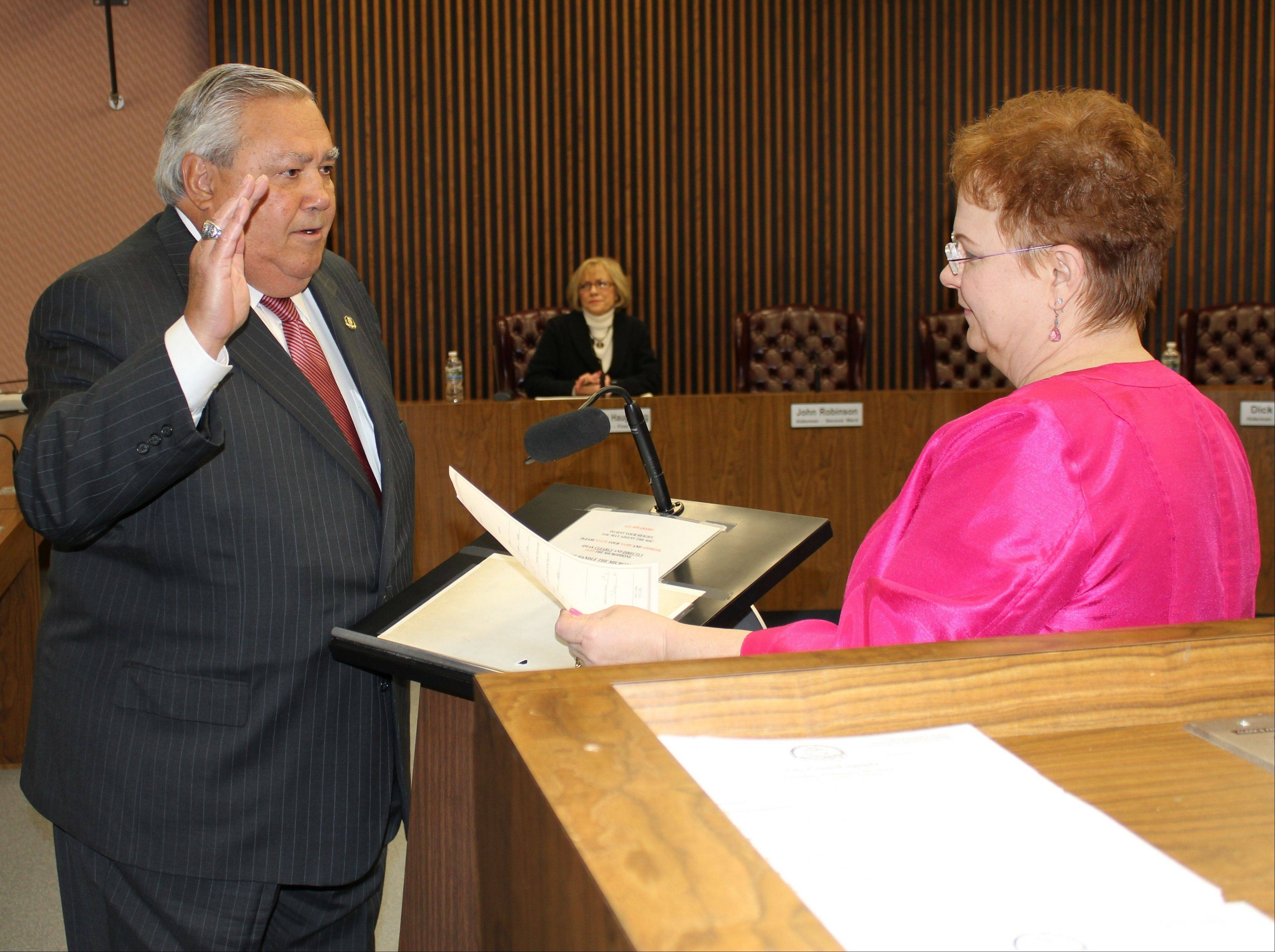 Fourth Ward Alderman Dick Sayad is sworn in as acting mayor of Des Plaines by City Clerk Gloria J. Ludwig at the Feb. 19 city council meeting.