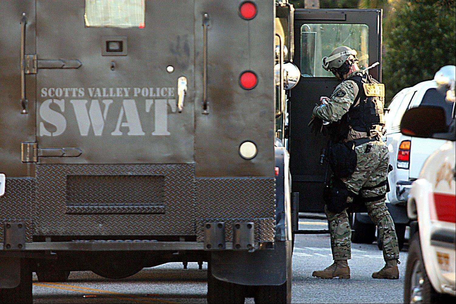 Santa Cruz County Sheriff�s Deputy member of the SWAT team gears up to enter the shooting scene Tuesday.