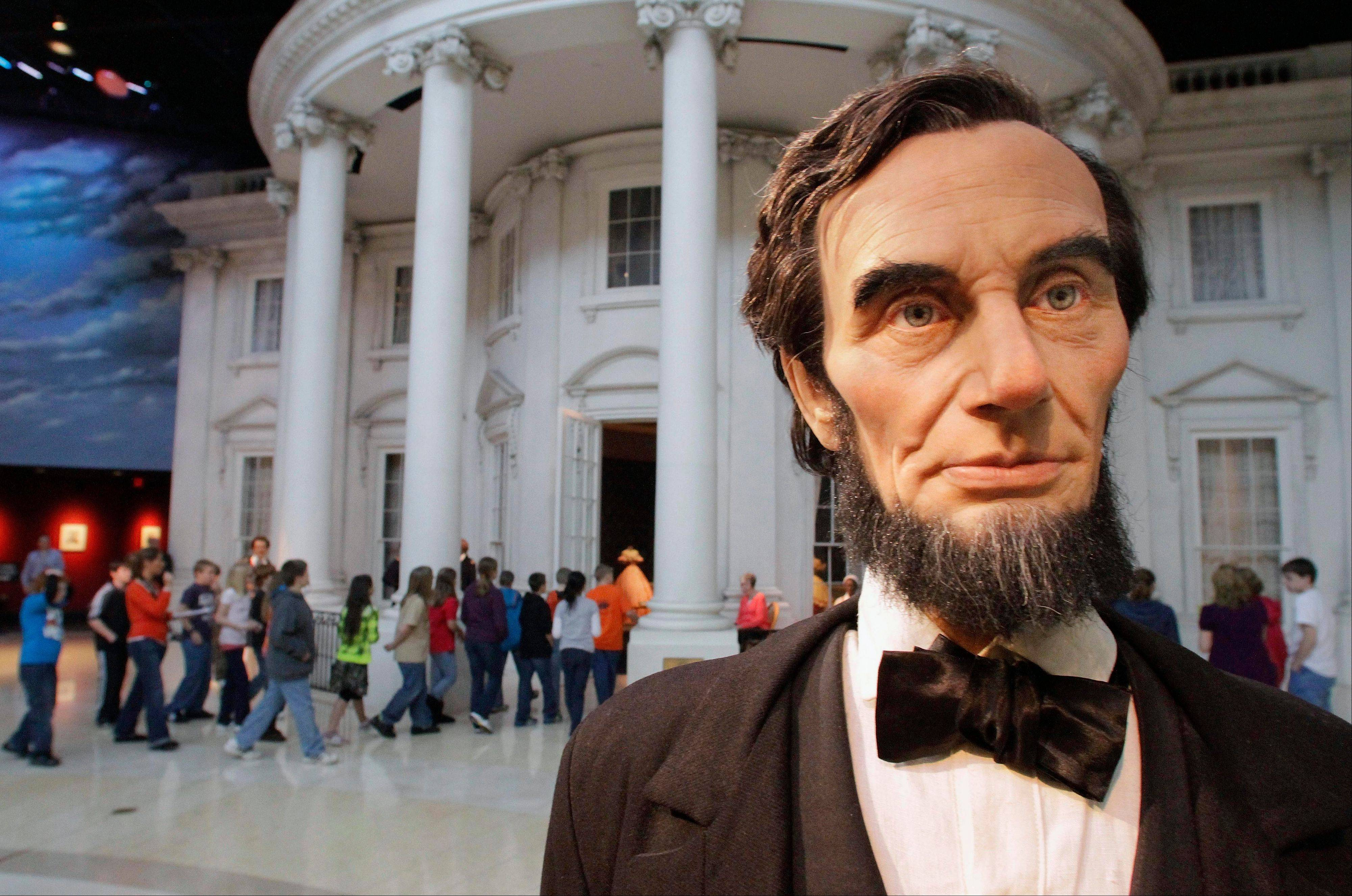 Students enter the �White House� as a life-size Abraham Lincoln replica stands outside at Abraham Lincoln Presidential Library and Museum in Springfield, Ill. Illinois wants to attract more international tourists and is harnessing the recent popularity of Lincoln.