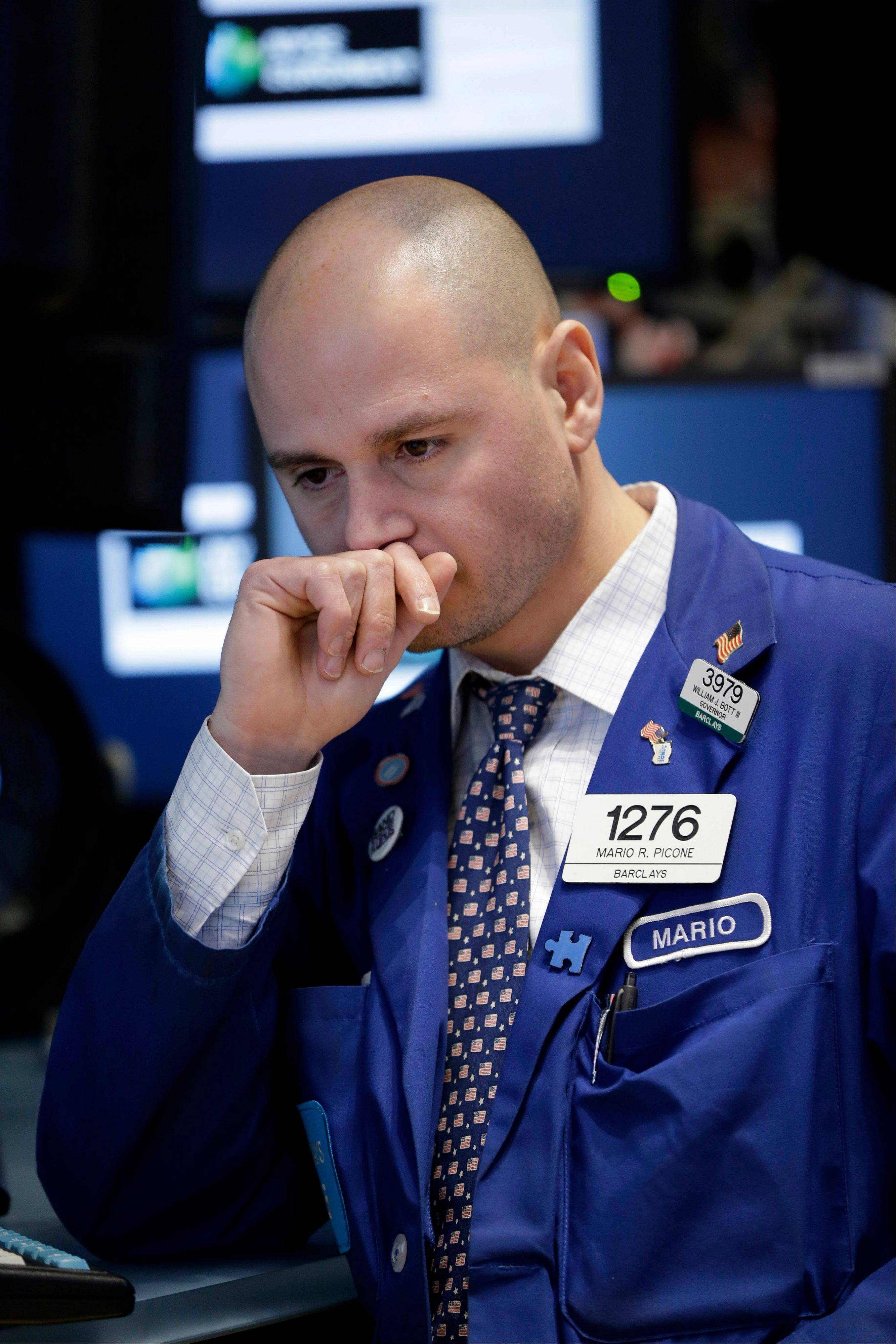 A trader works on the floor Wednesday at the New York Stock Exchange in New York.