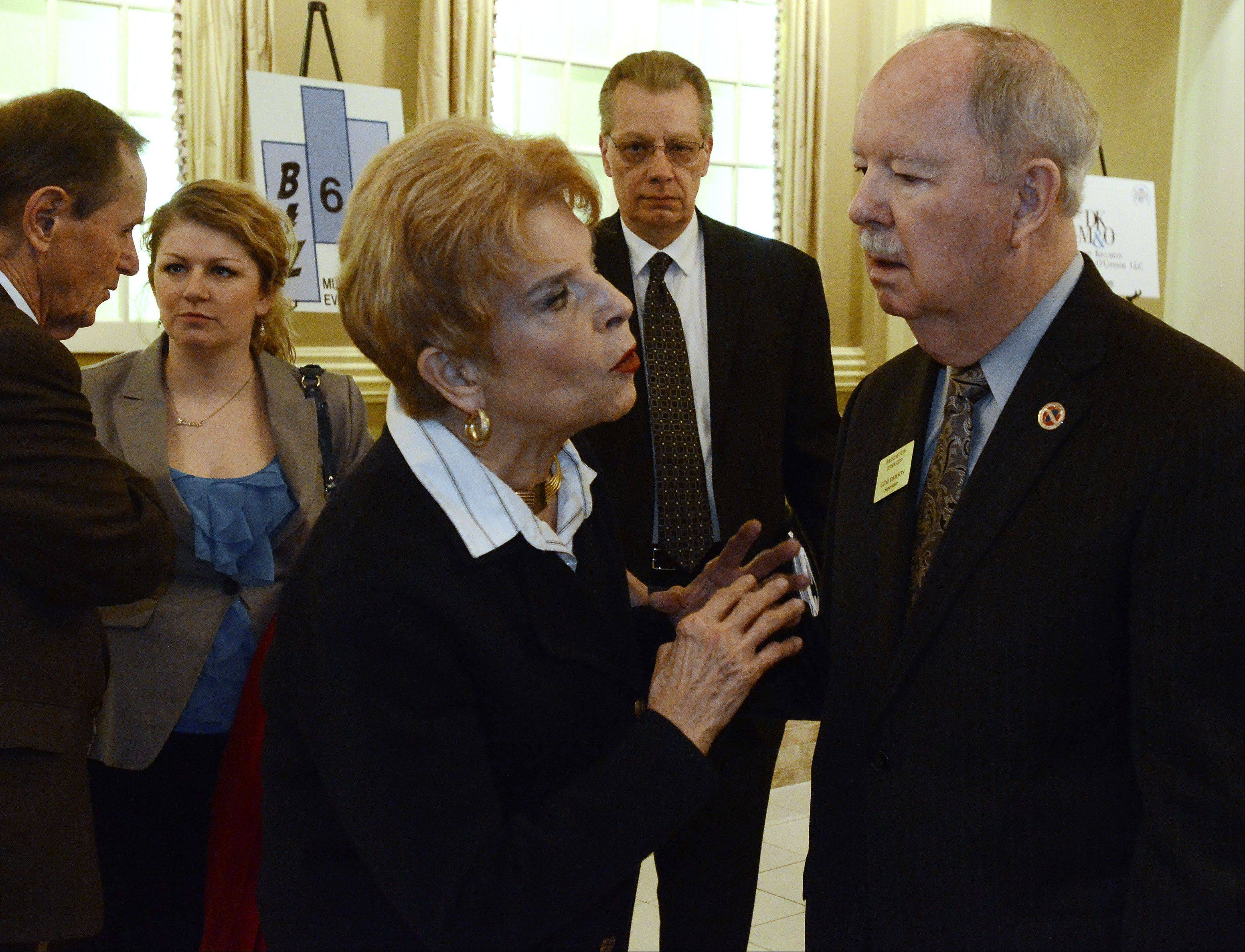 Comptroller Judy Baar Topinka speaks with Barrington Township Supervisor Gene Dawson before the luncheon.