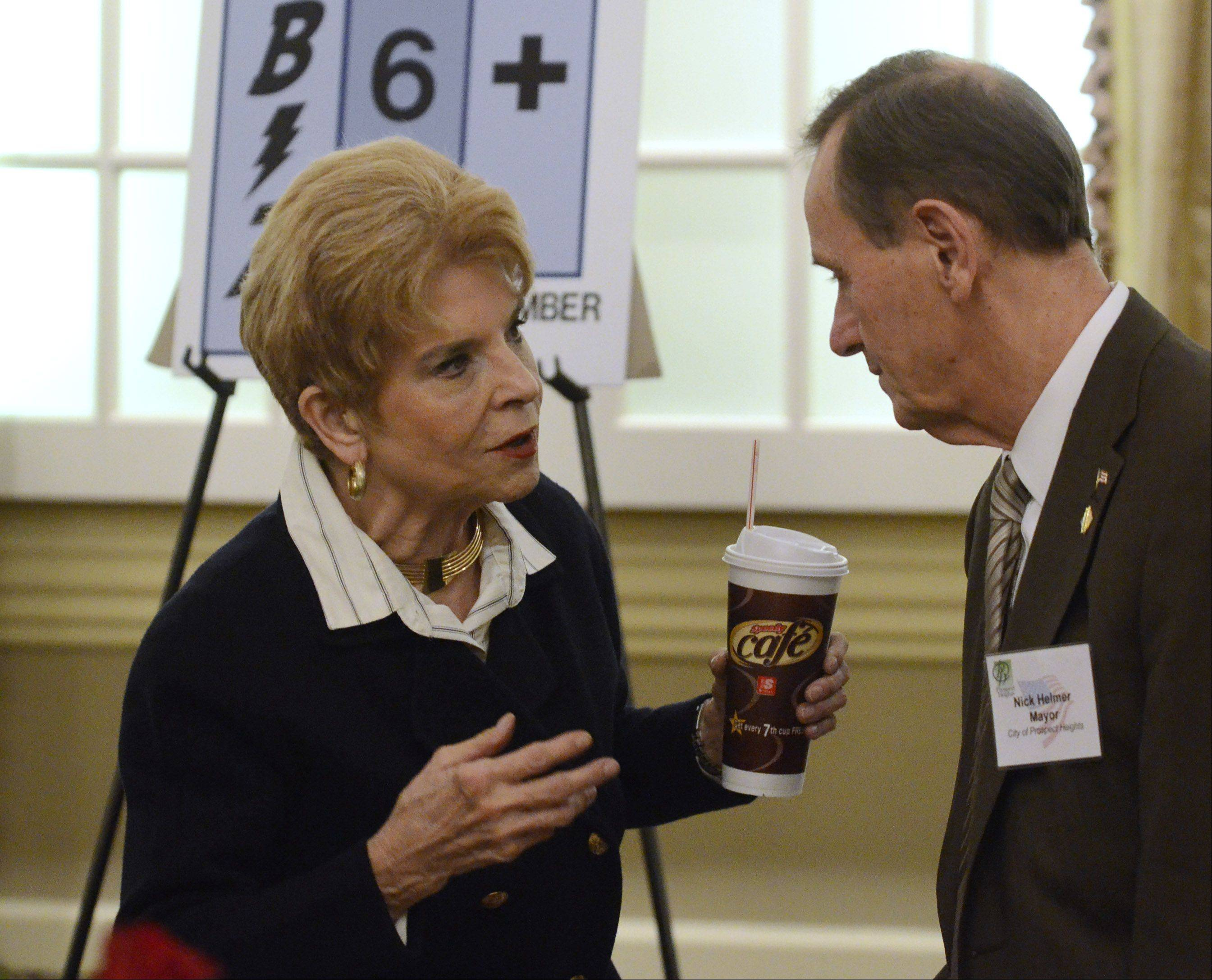 Comptroller Judy Baar Topinka confers with Prospect Heights Mayor Nick Helmer after the luncheon.