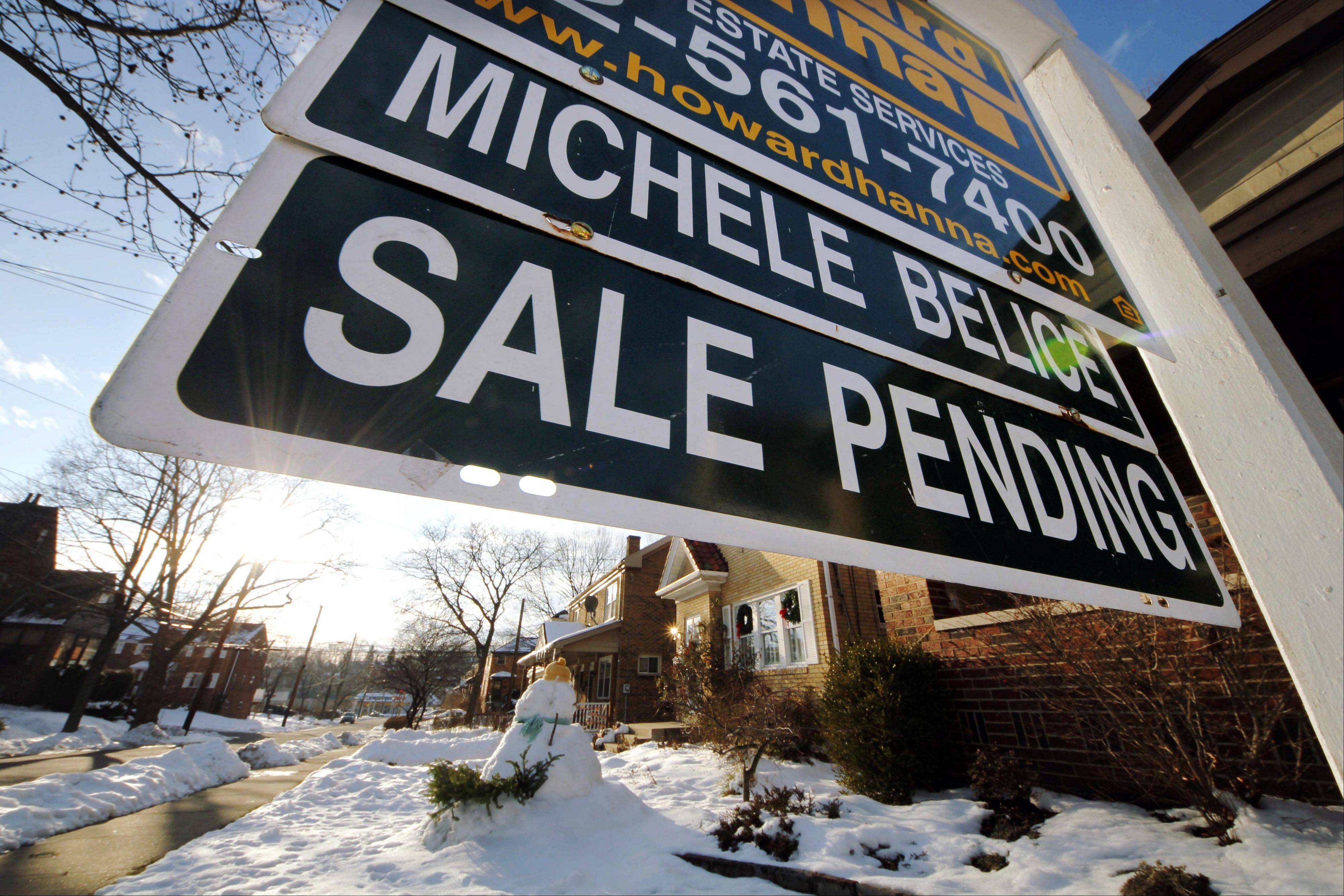 A measure of the number of Americans who signed contracts to buy homes rose in January from December to the highest level in more than 2 � years. The increase suggests sales of previously occupied homes will continue rising in the coming months.